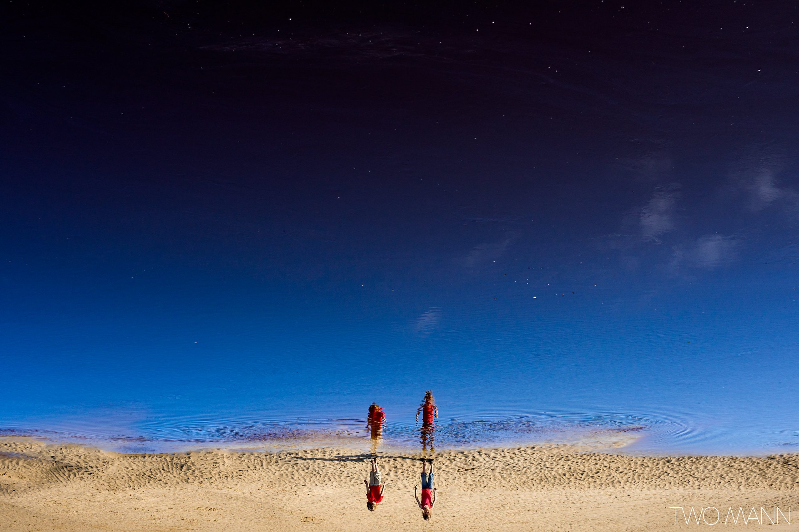 Kids wading on beach in Australia on starry night
