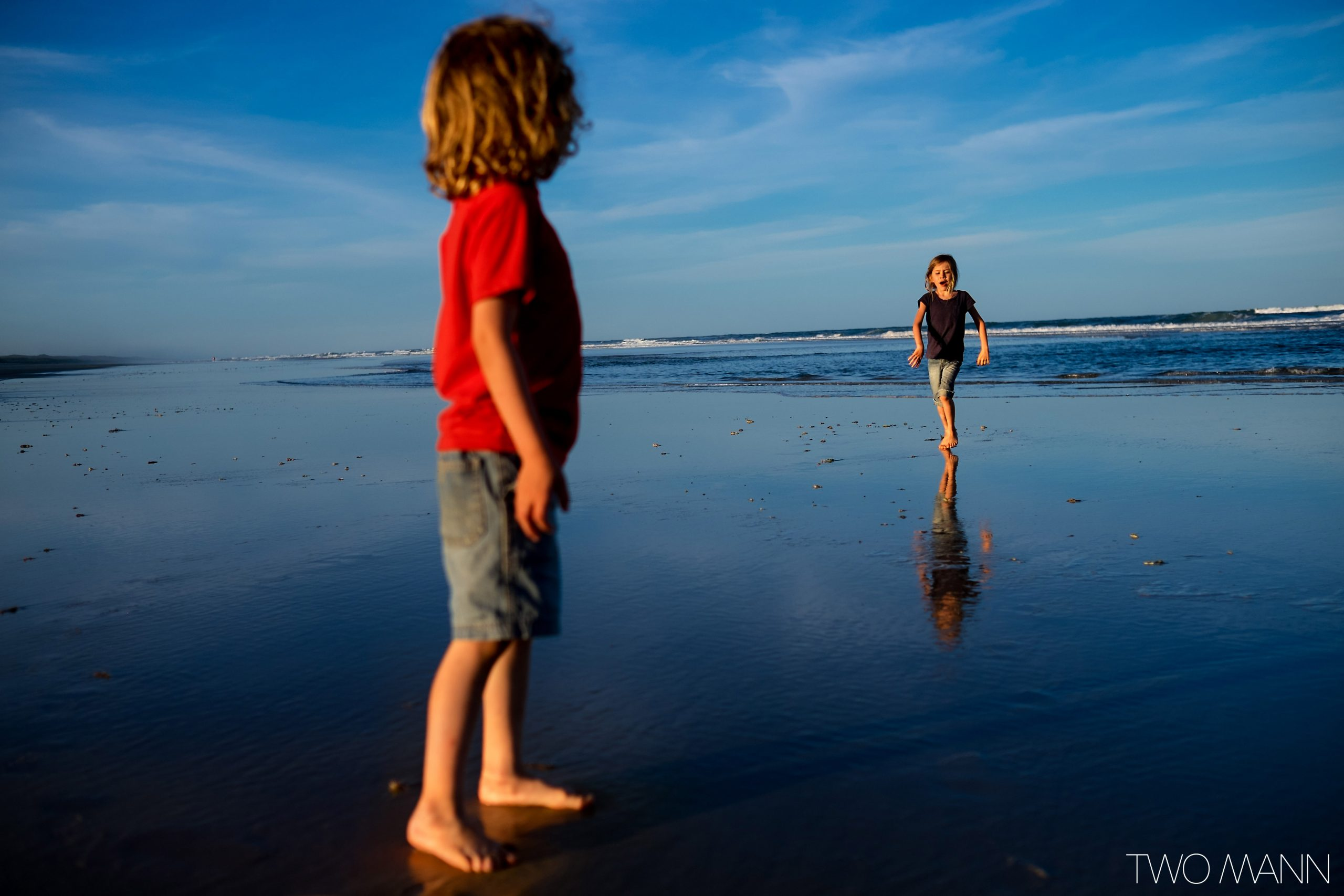 Young boy and girl playing on the beach