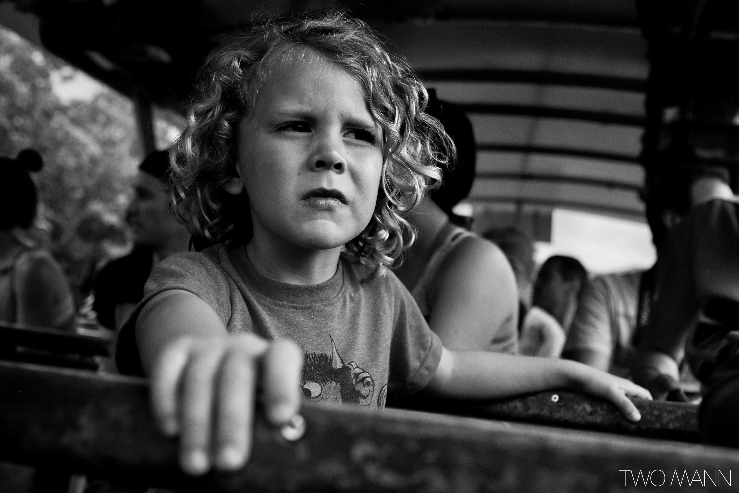 Young boy on bus looking displeased