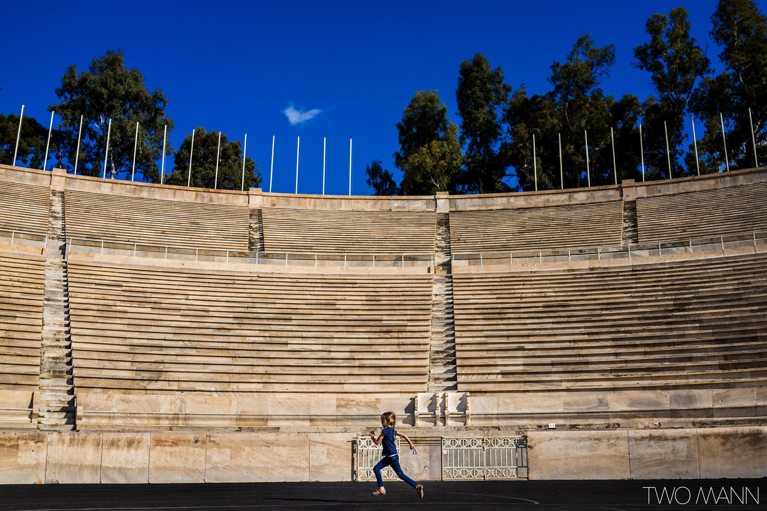 Young girl running inside Panathenaic Stadium