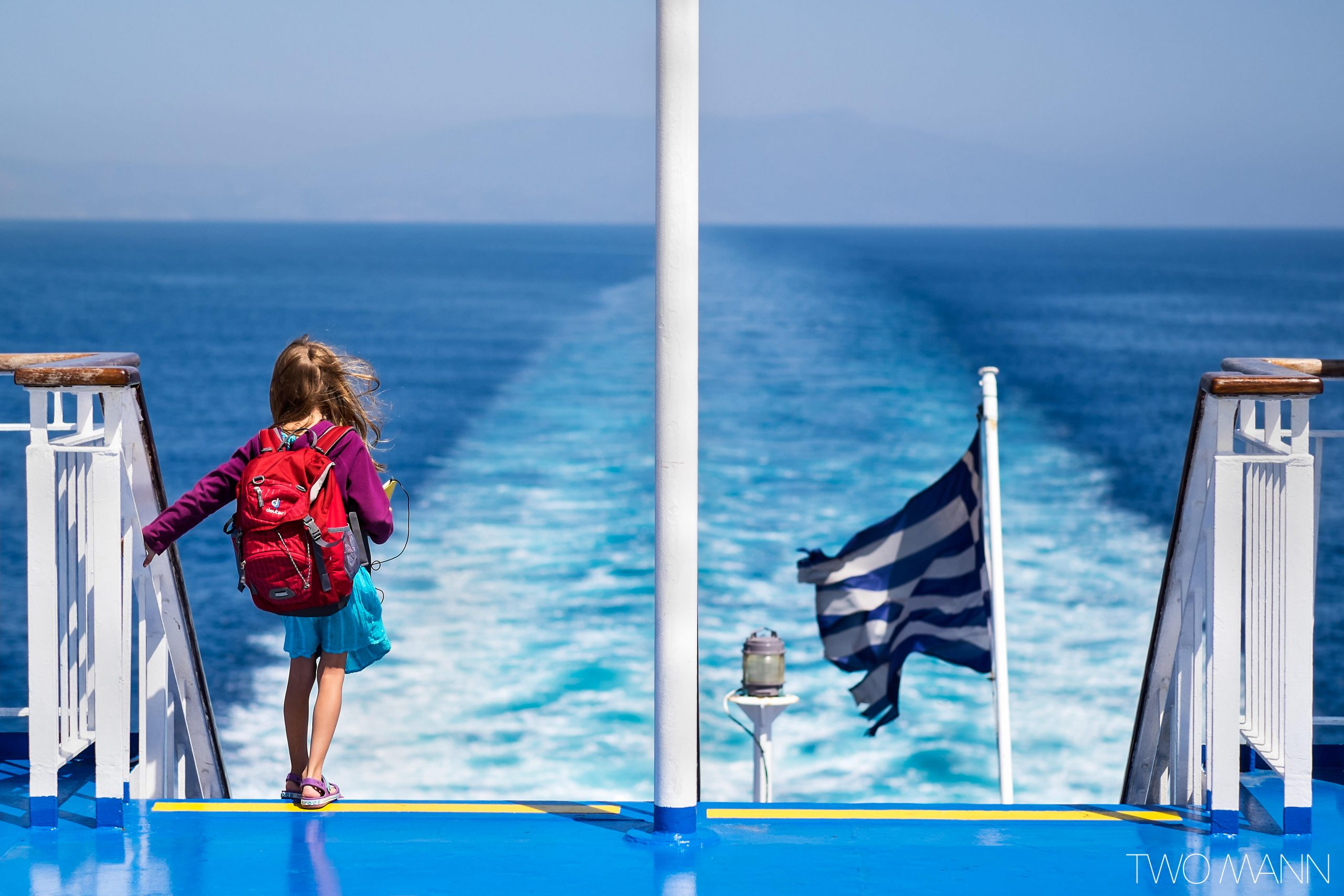 Young girl on ferry with Greek flag
