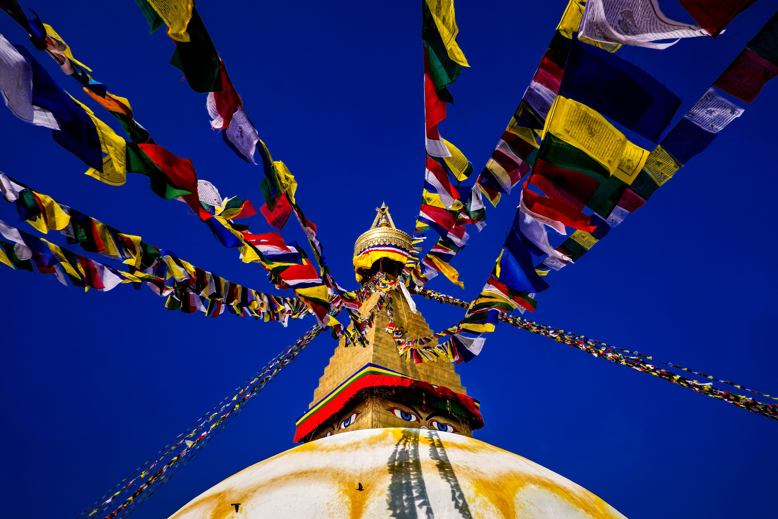 Traditional Nepalese flags tied to top of temple