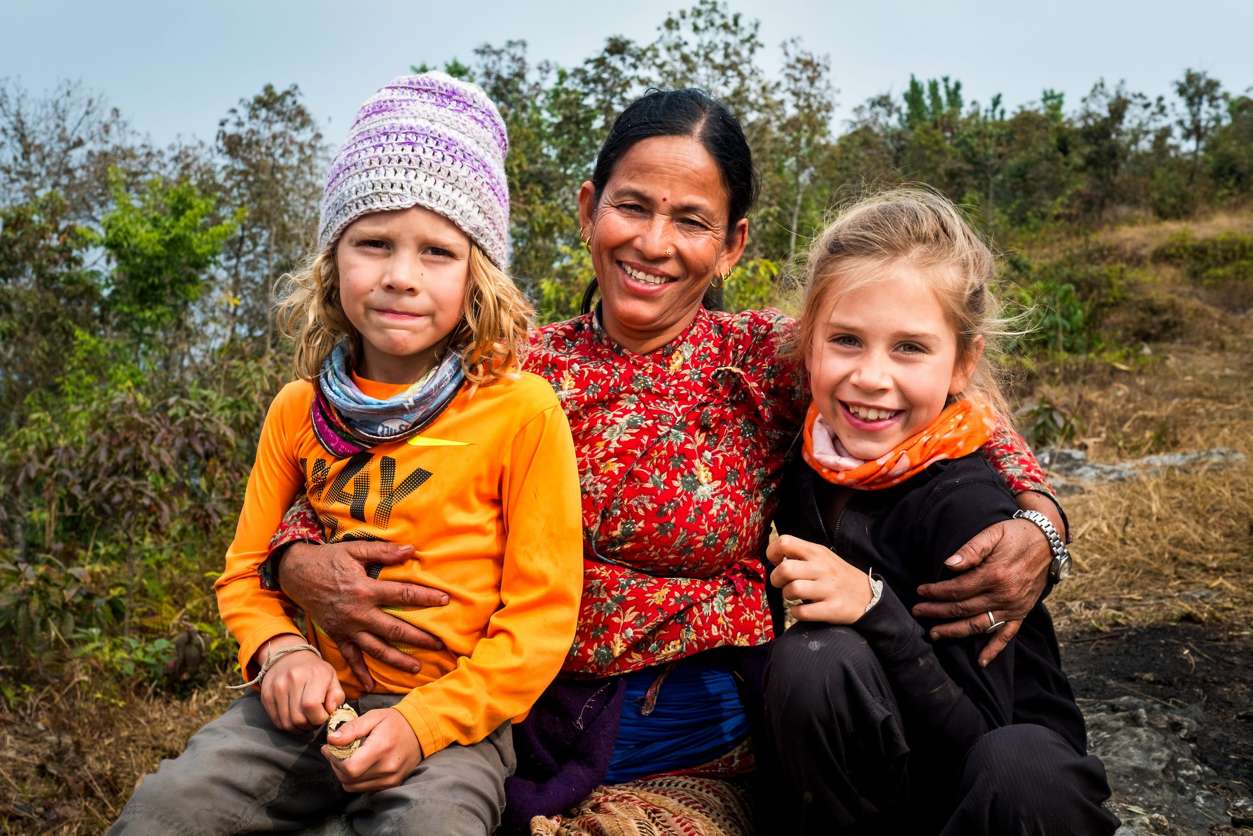 Kids take photo with local Nepalese woman