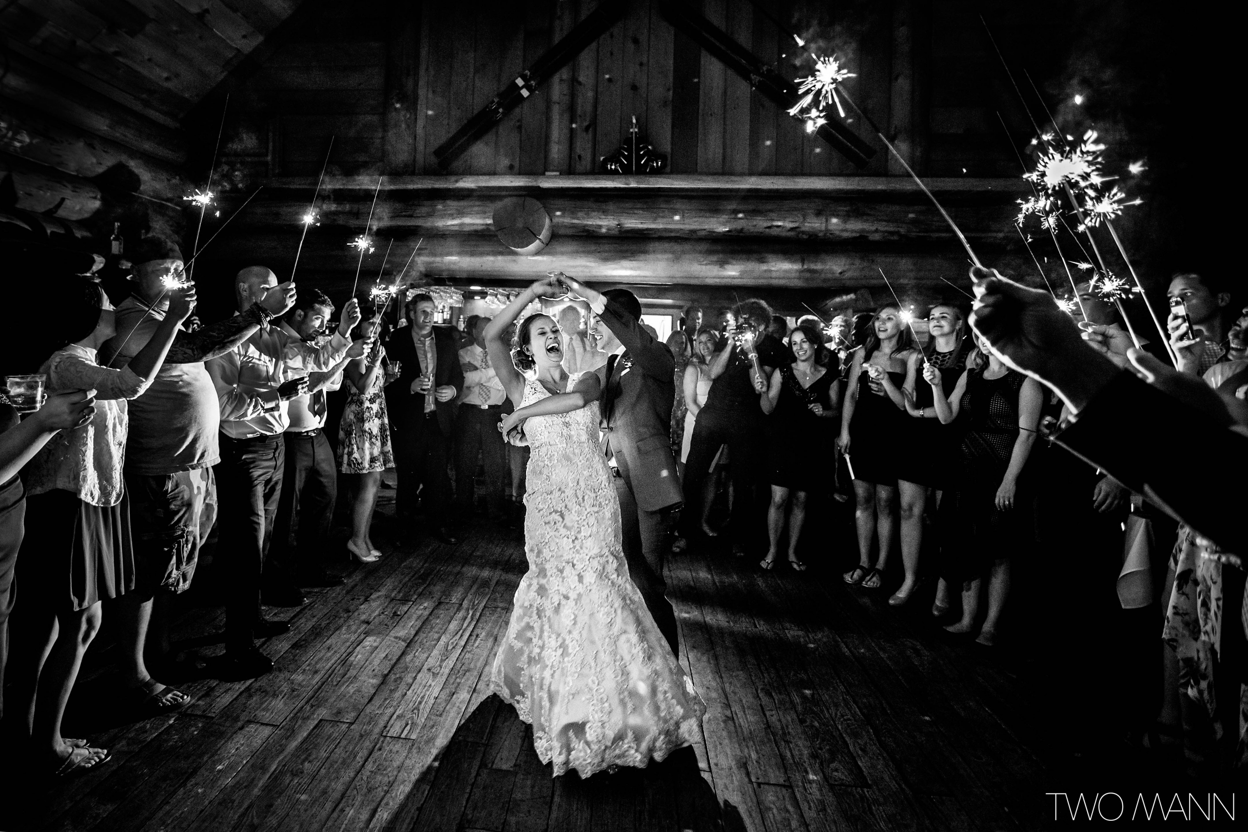 bride and groom first dance with electric fireworks