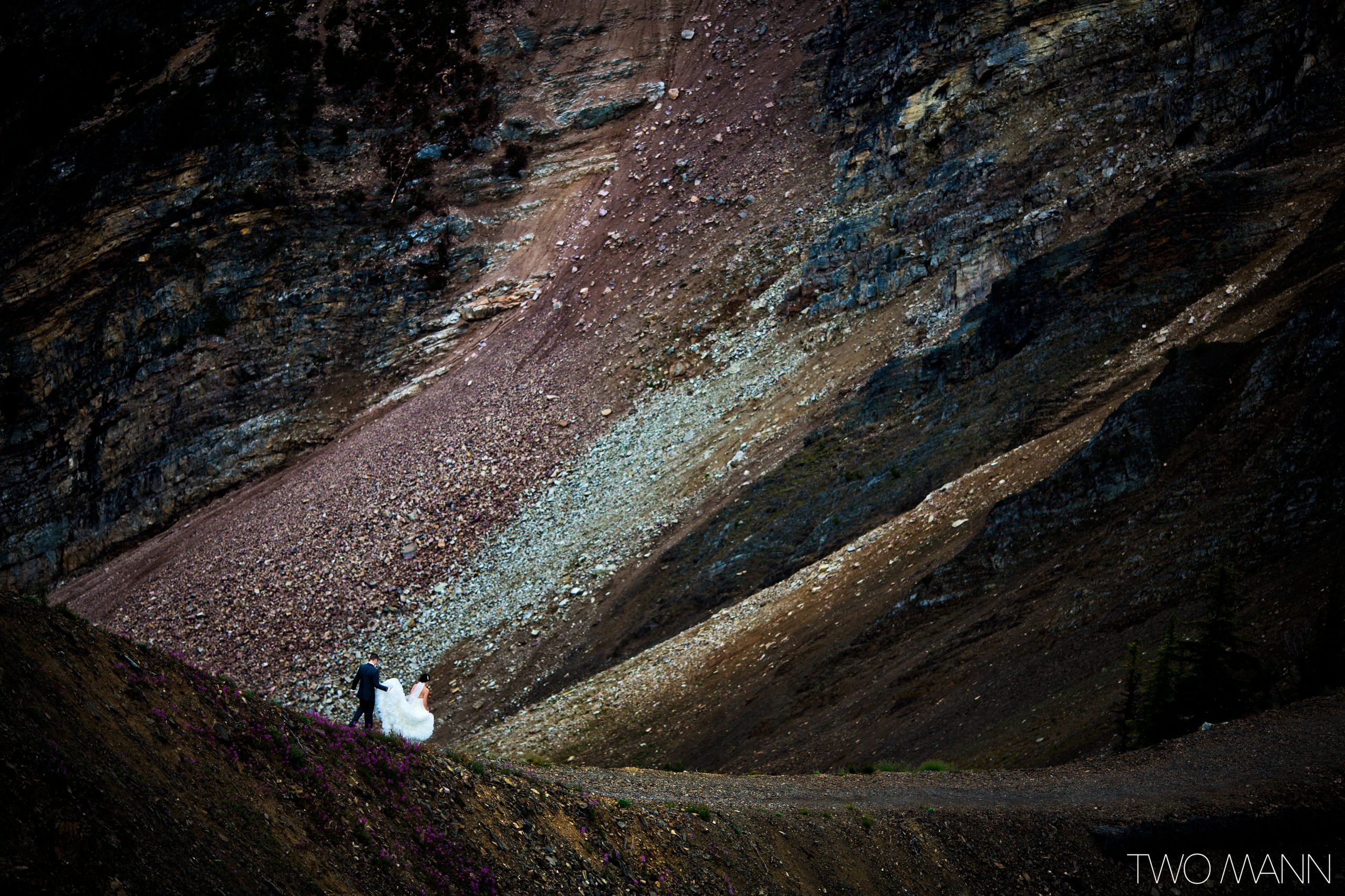 bride and groom walking on kicking horse mountain Canada in summer