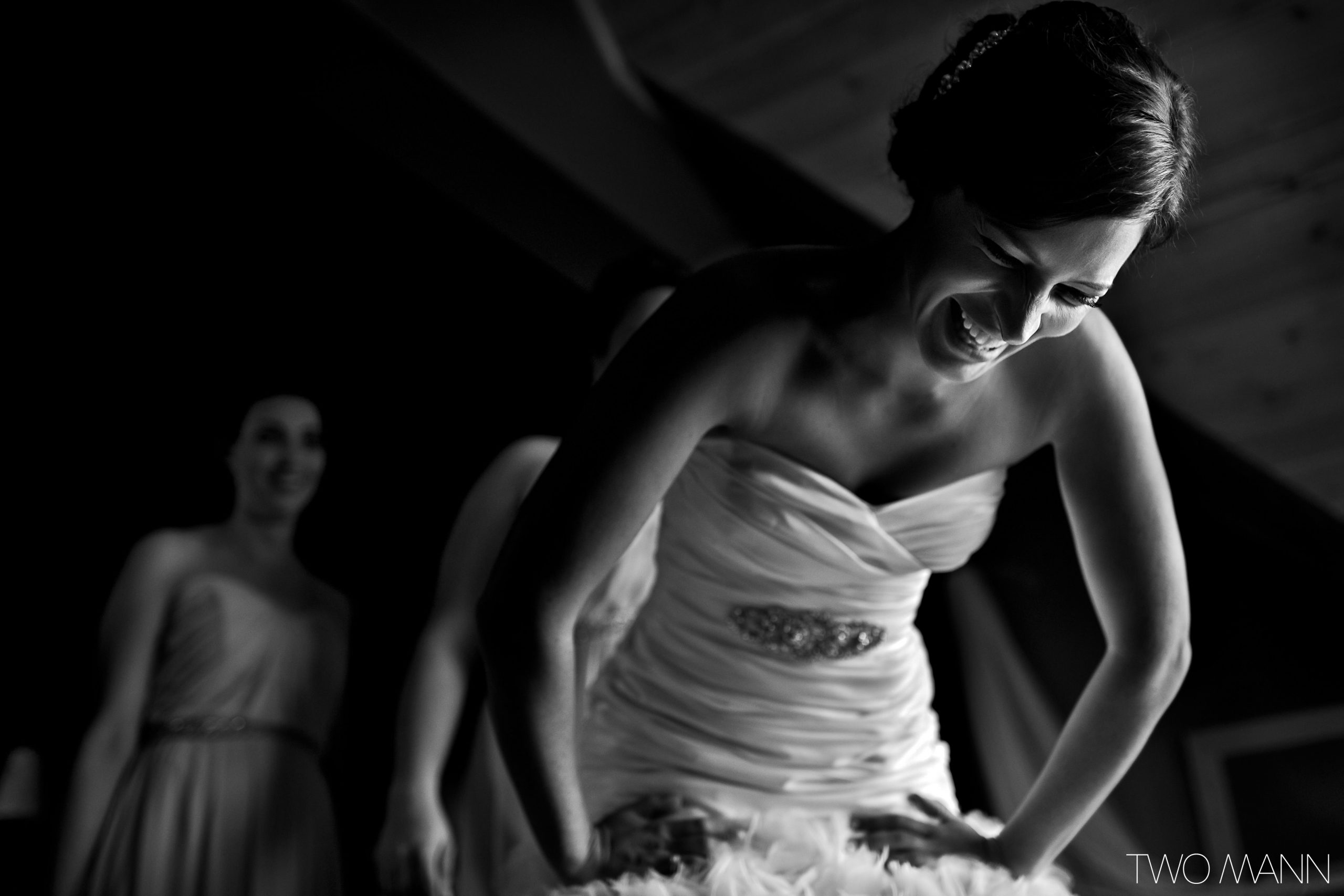 a bride putting on her wedding dress
