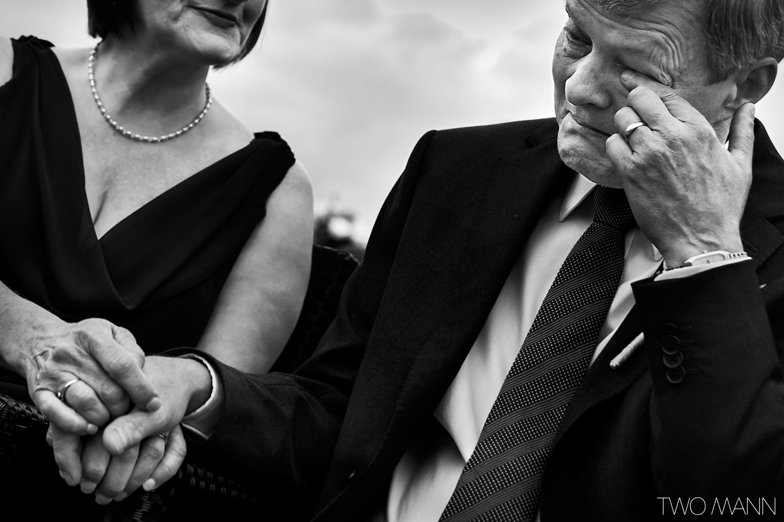 emotional parents at a wedding ceremony