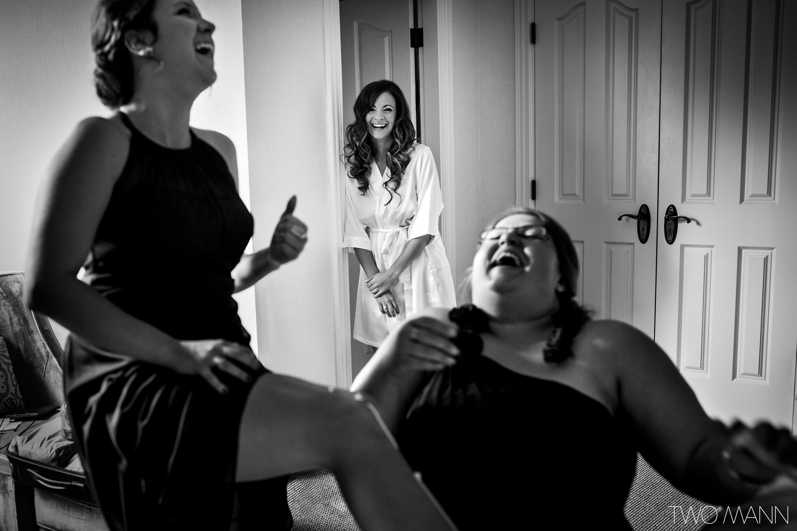 happy bride and bridesmaids during preparation for the ceremony