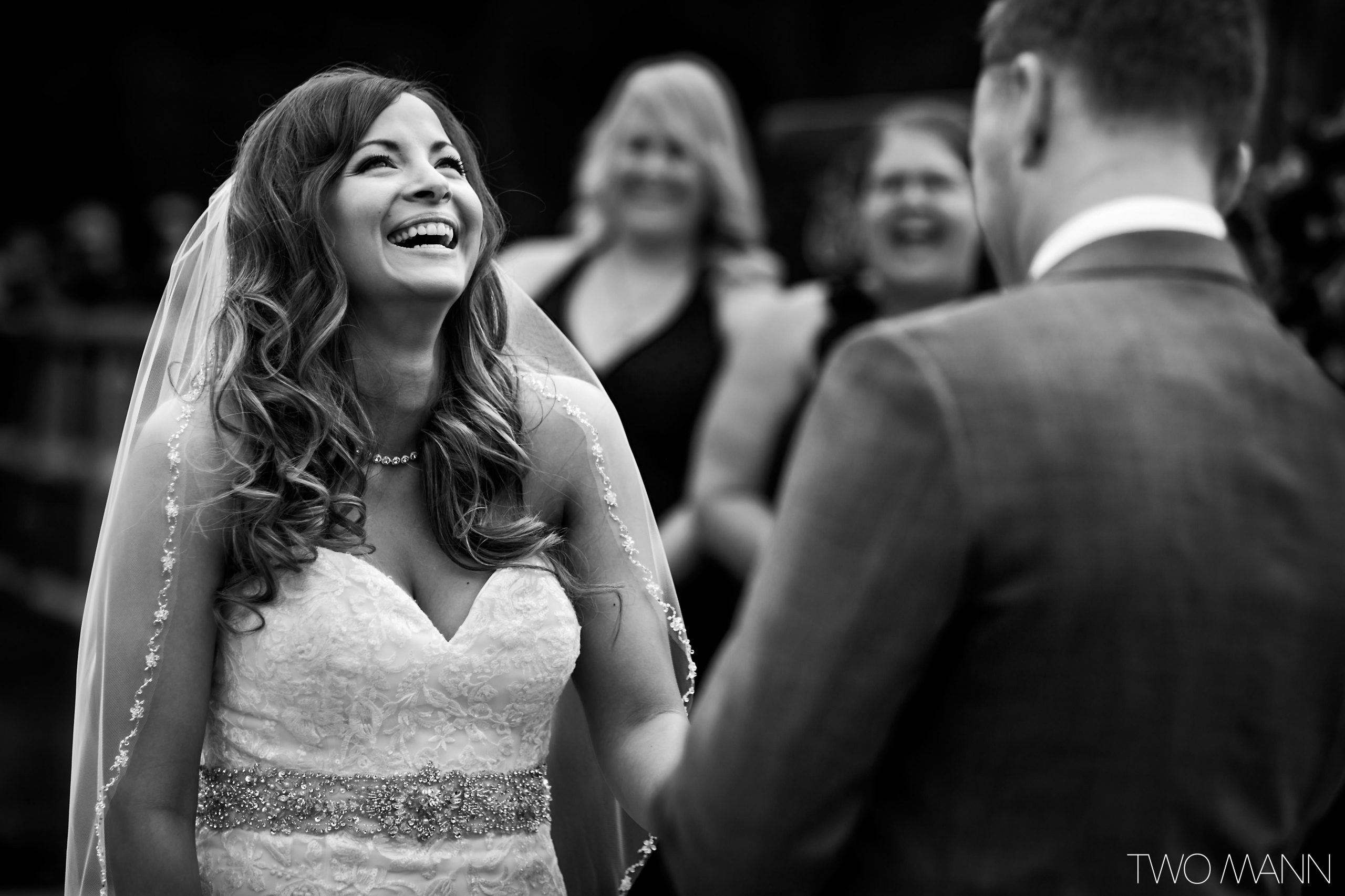 a smiling bride at wedding ceremony