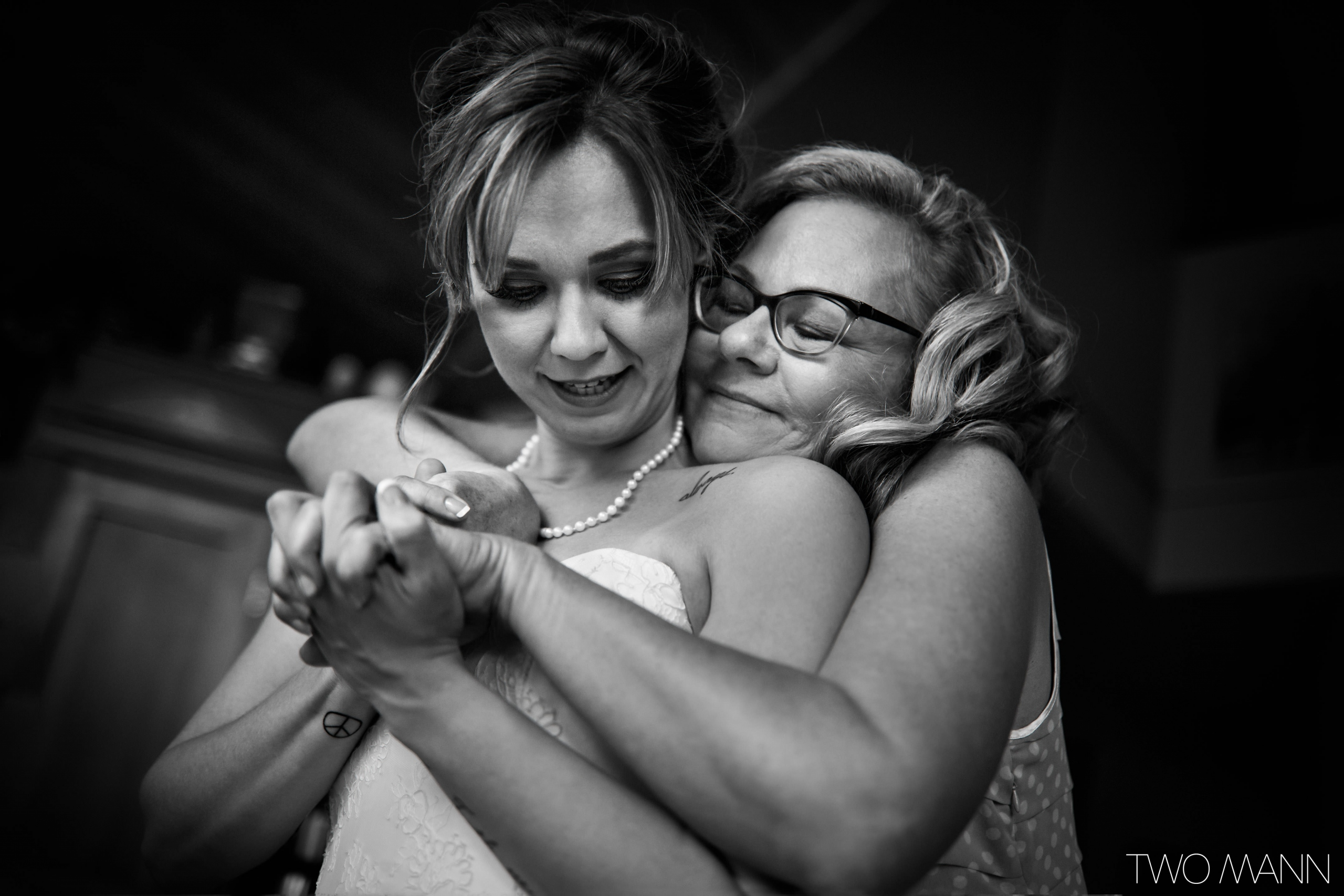 mom hugging daughter from back