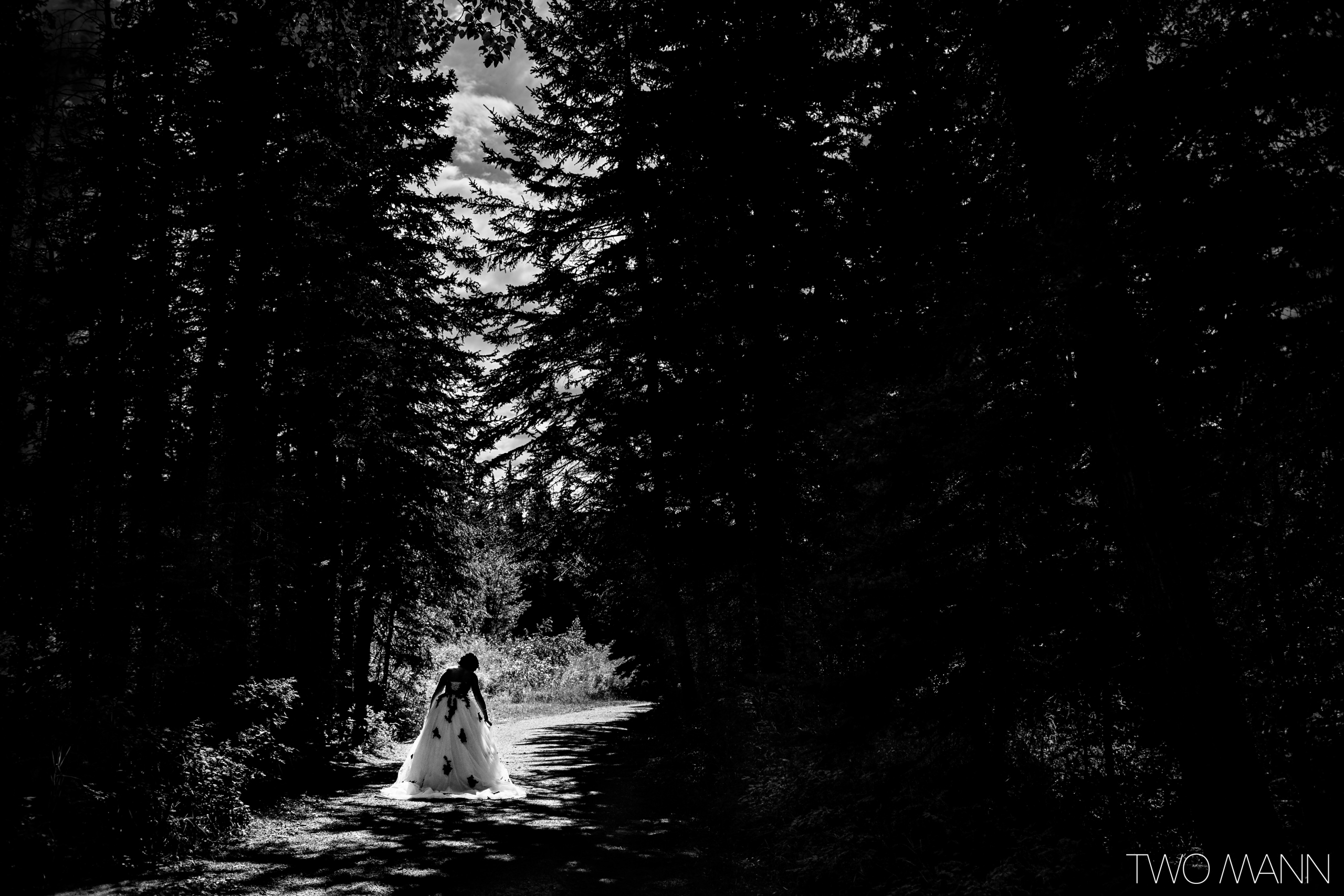 a bride walking in the forest