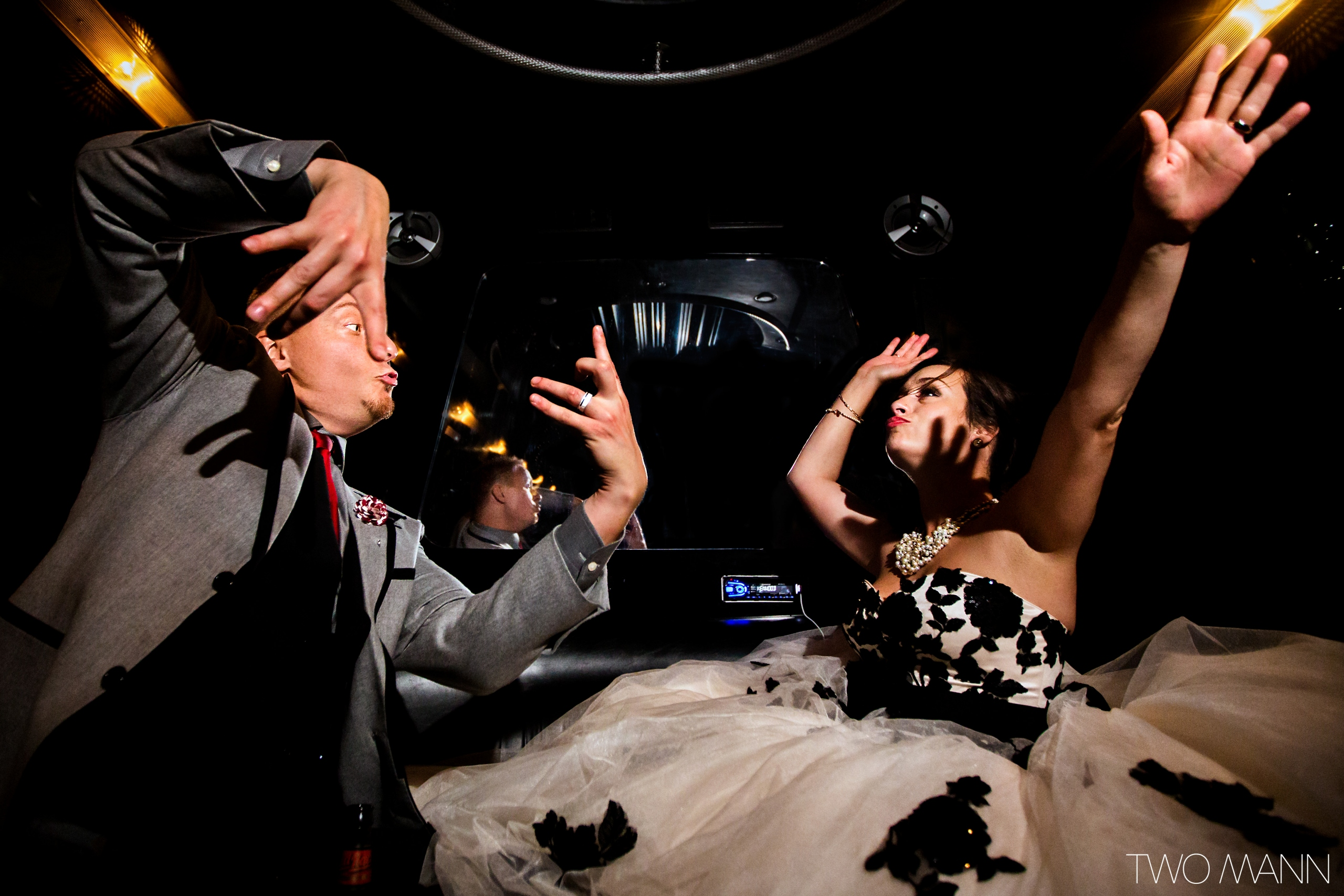 bride and groom dancing at a celebration party in a limo