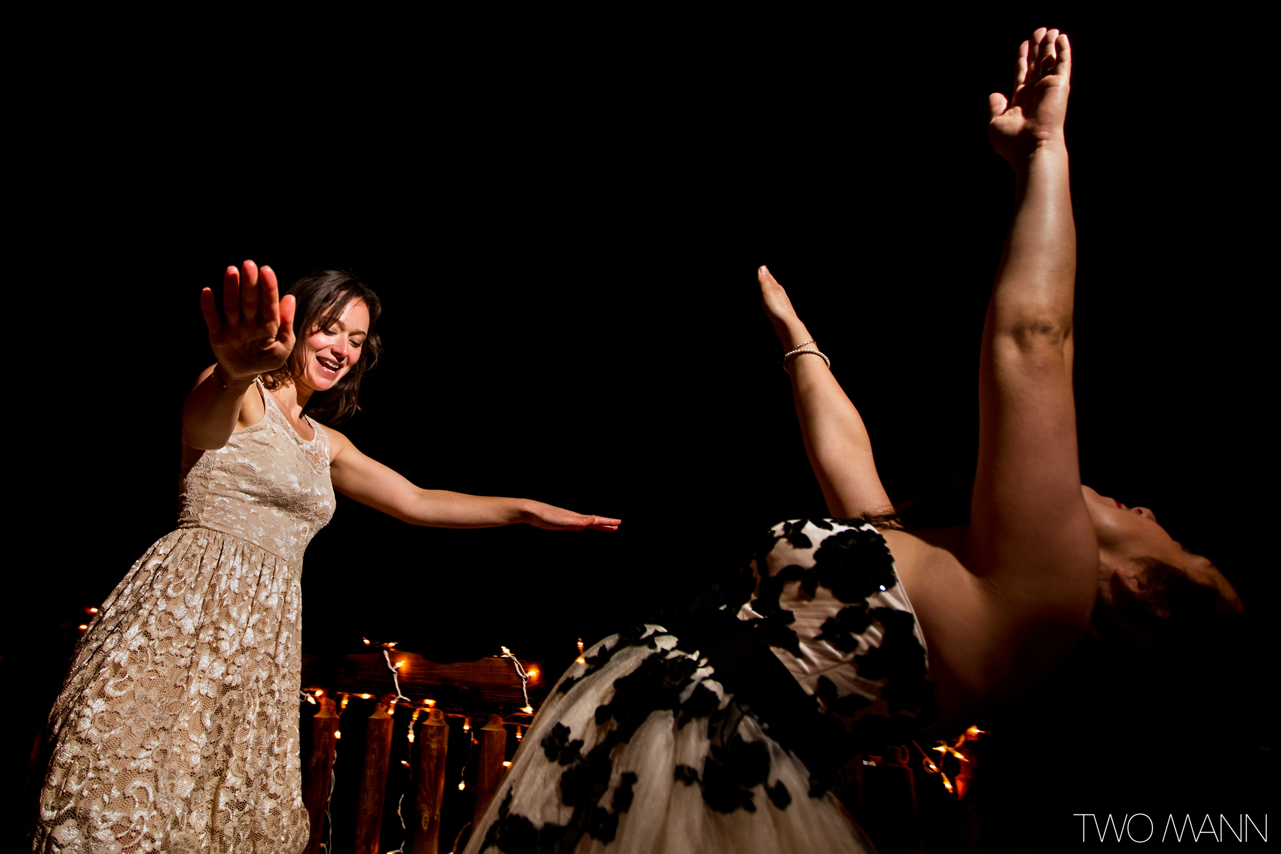 bride and a girl friend dancing at reception