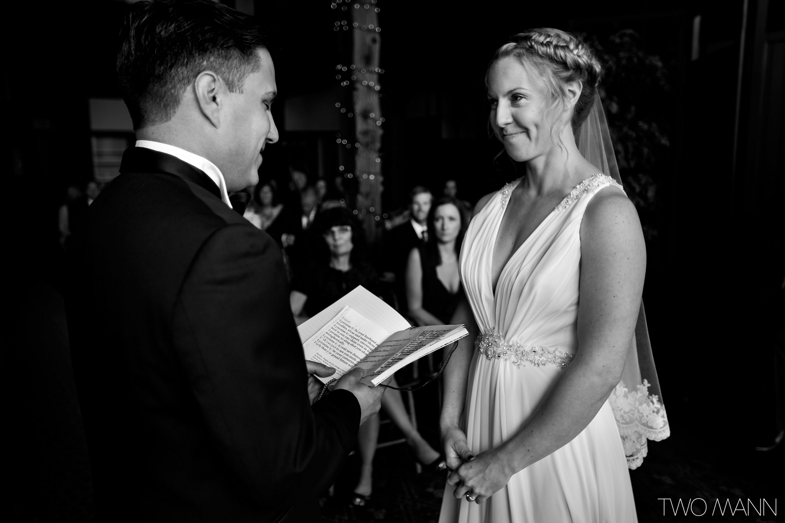 a groom reading marriage vows to his bride
