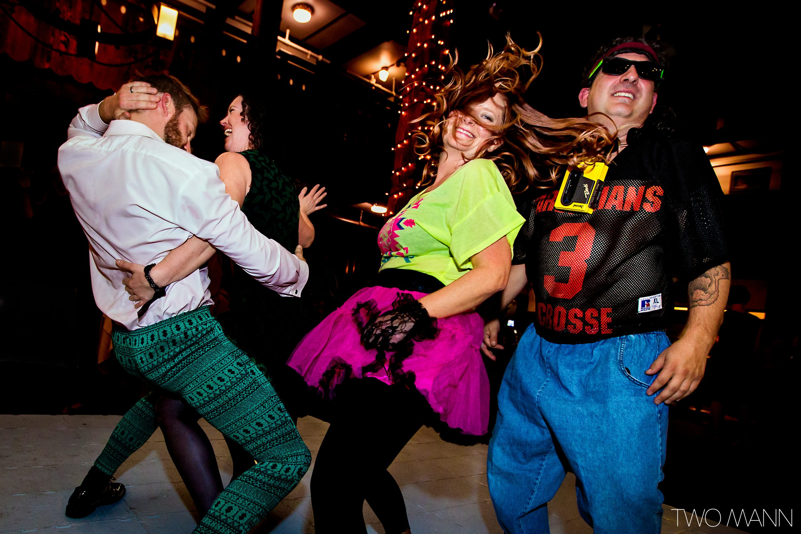 groom and wedding guests dancing at a retro 80's reception dance party