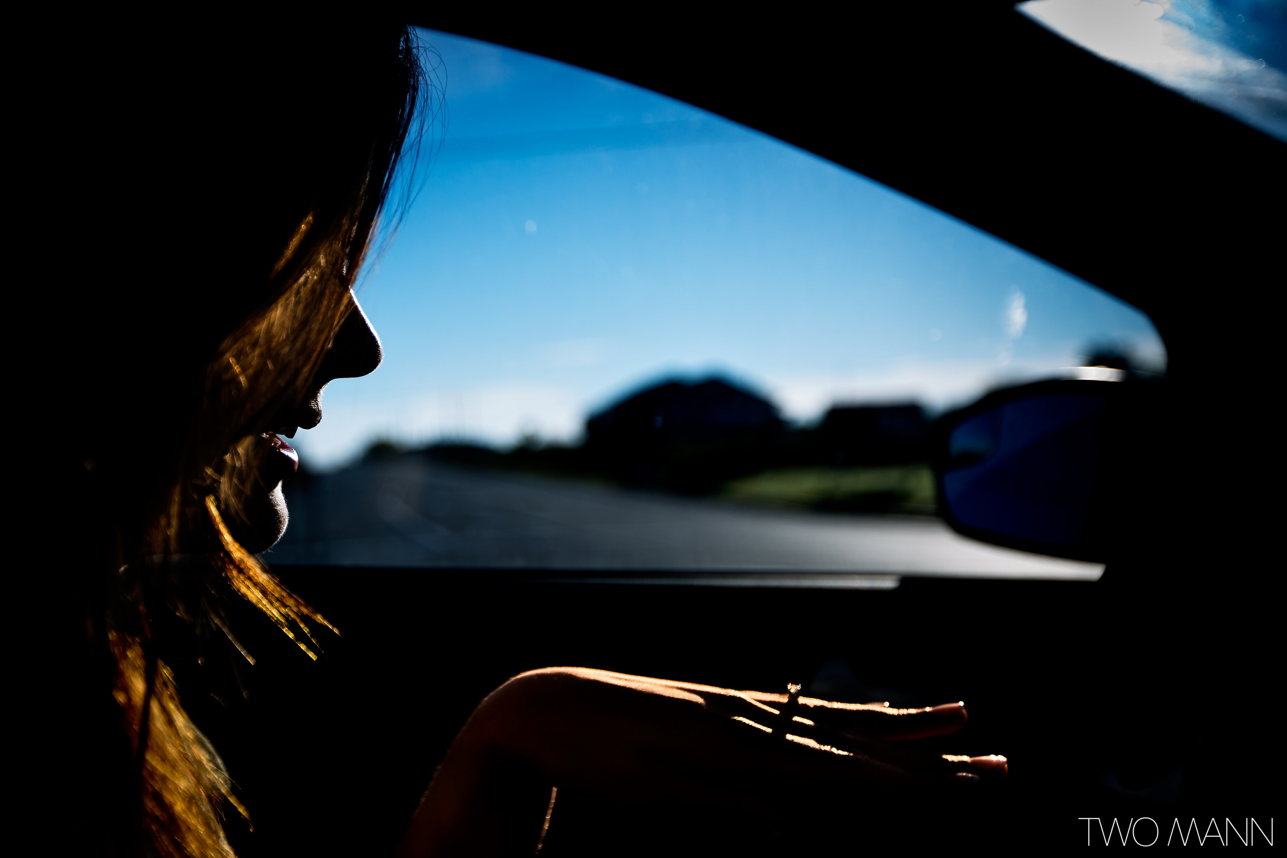 a bride looking at her ring in a car