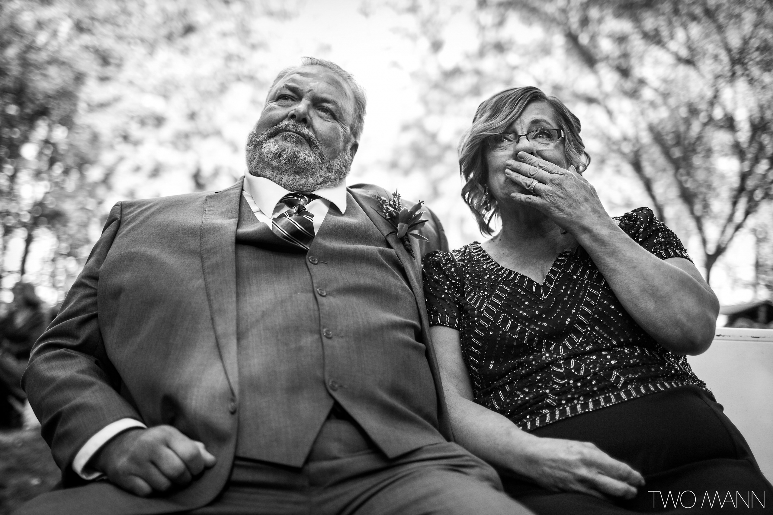 emotional bride's parents at wedding ceremony