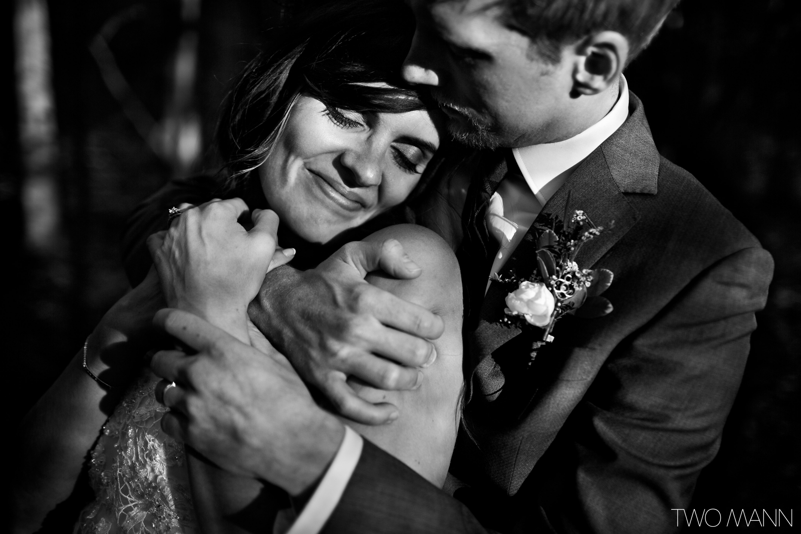groom embracing a happy bride from back