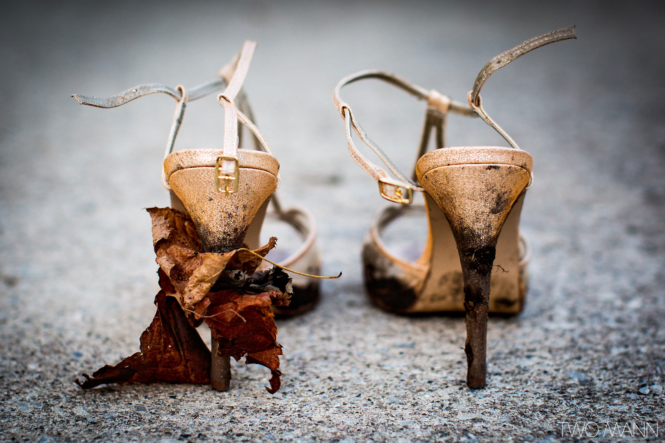 bride's shoes with leaves and mud on the heels