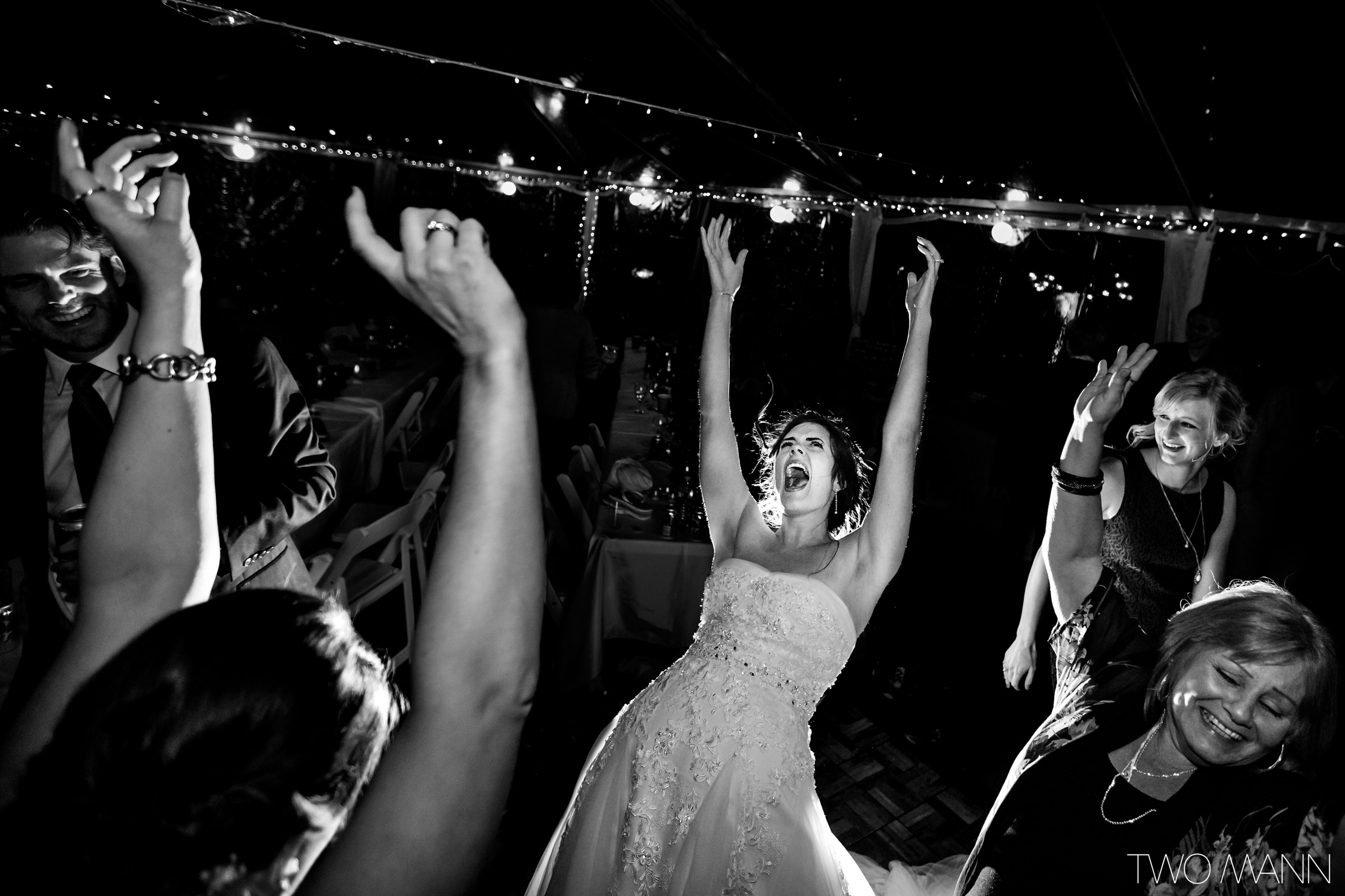 bride and friends dancing together at reception