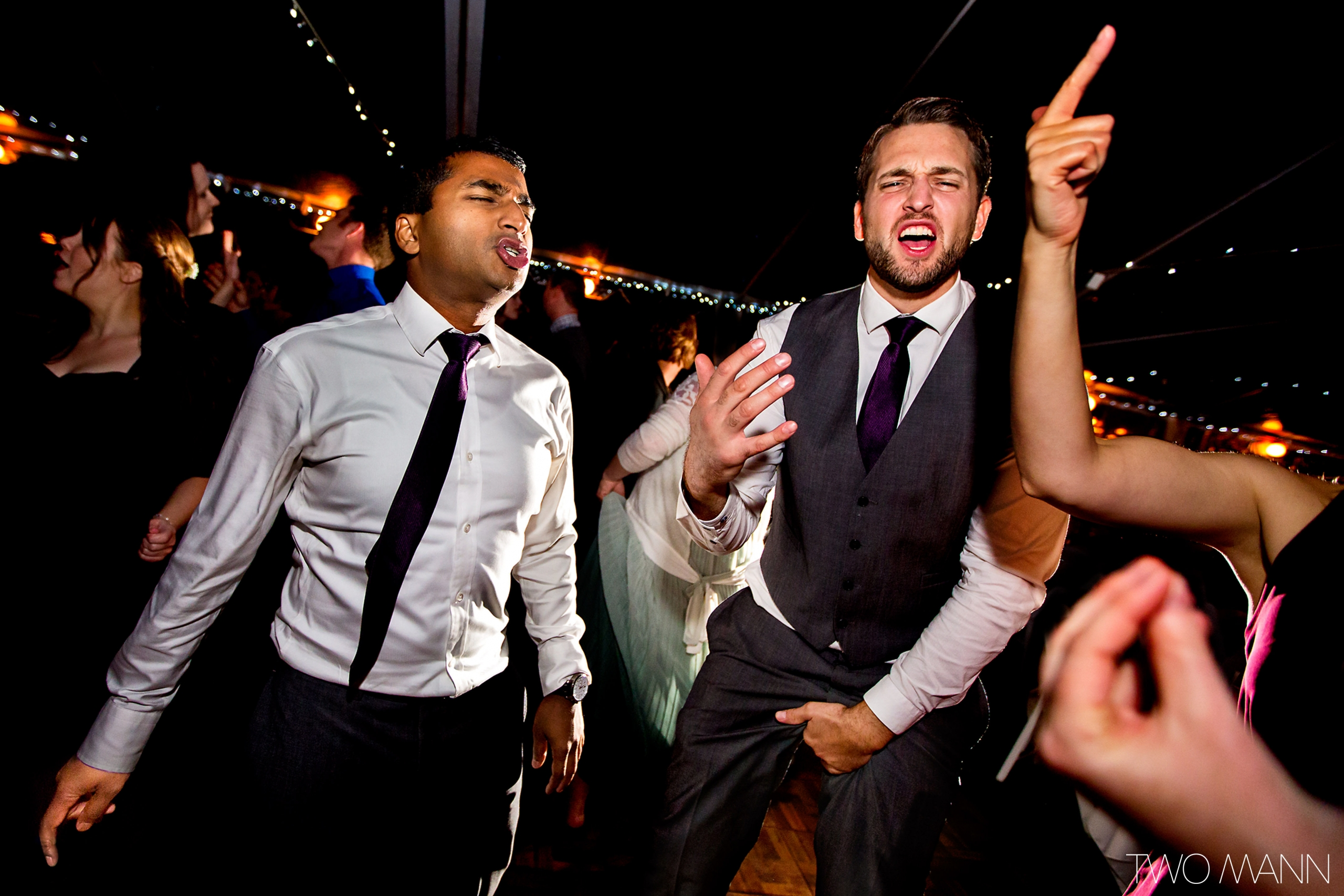 groom and friends dancing together at reception