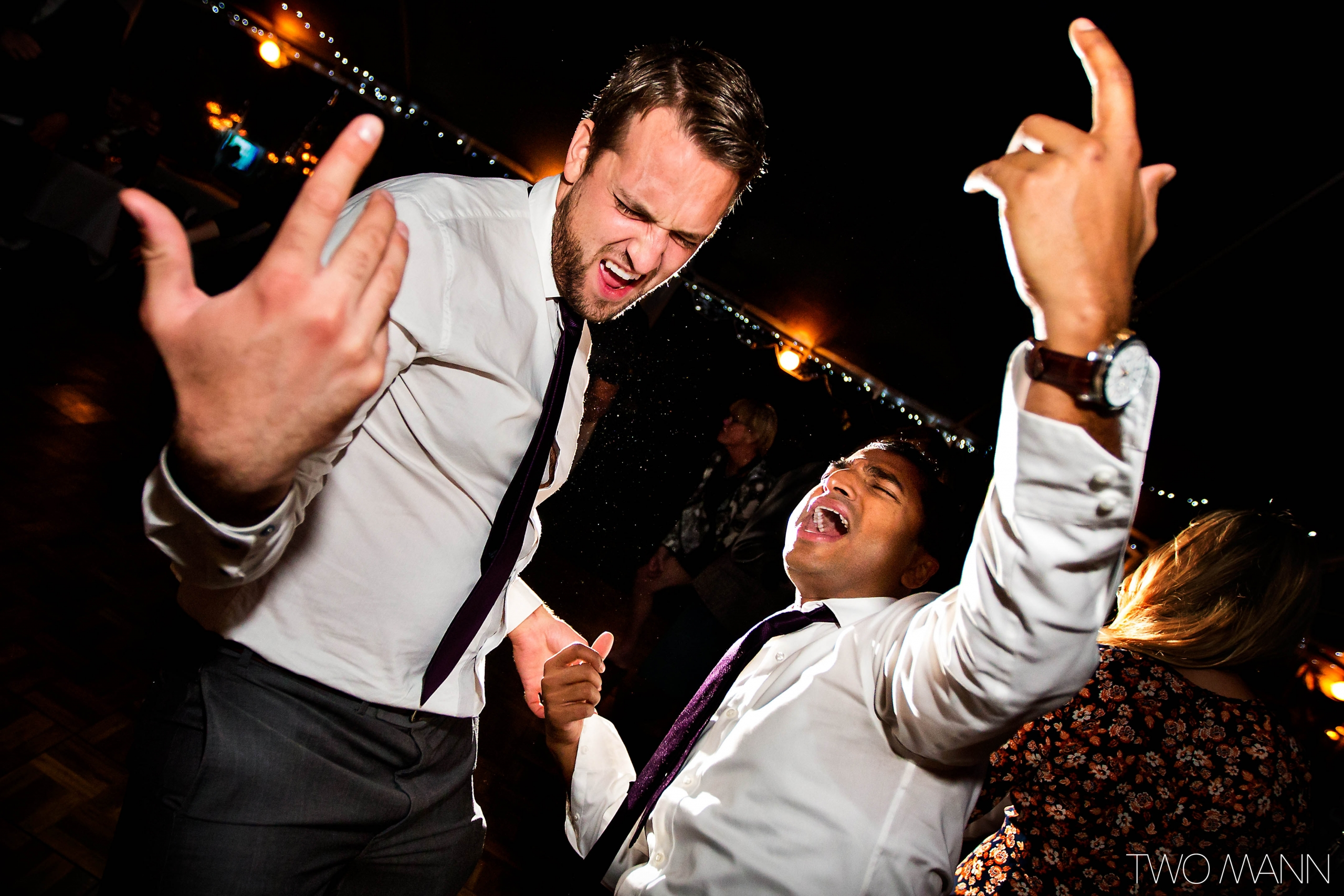 groom and friends hitting the dance floor