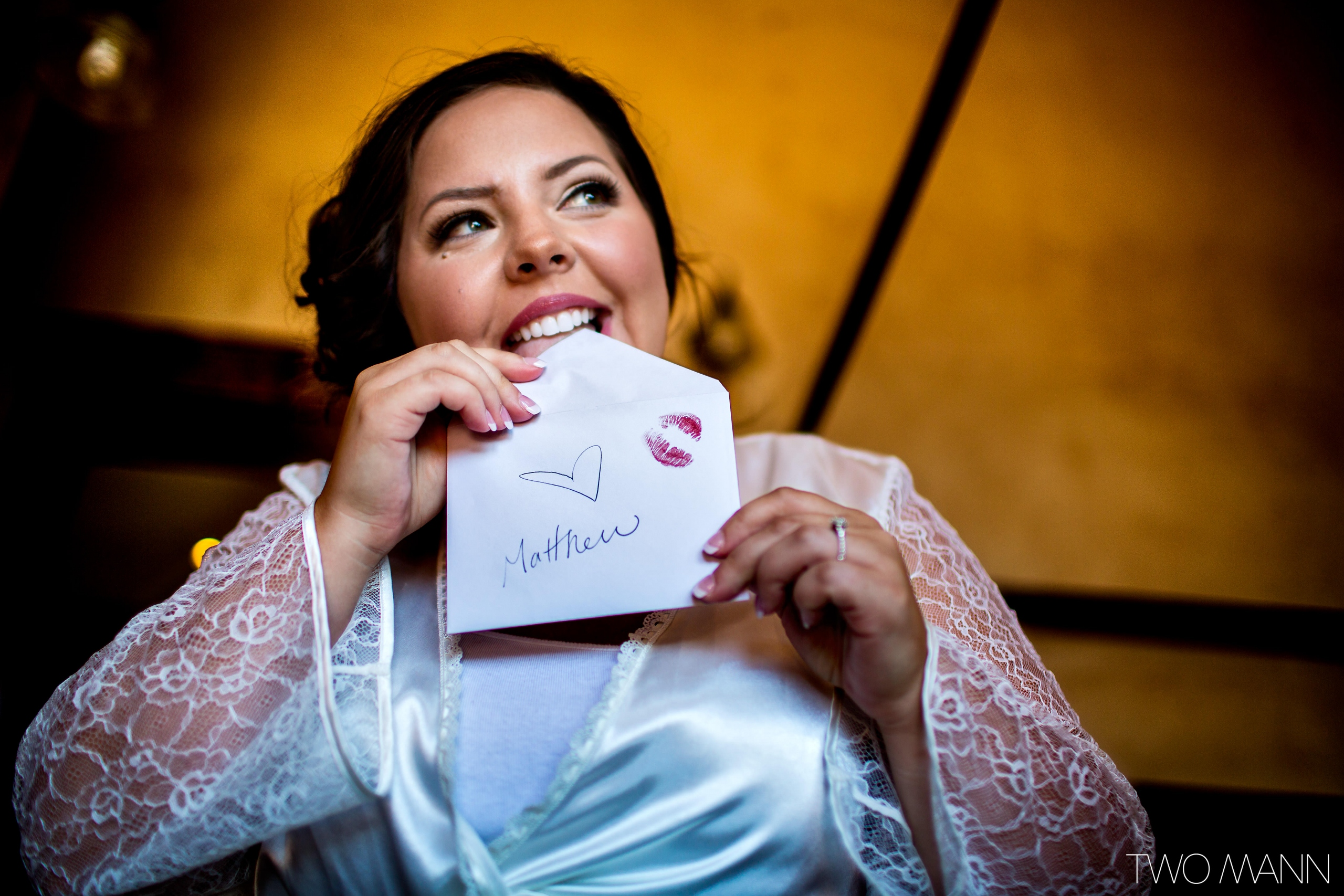 a bride licking an envelope