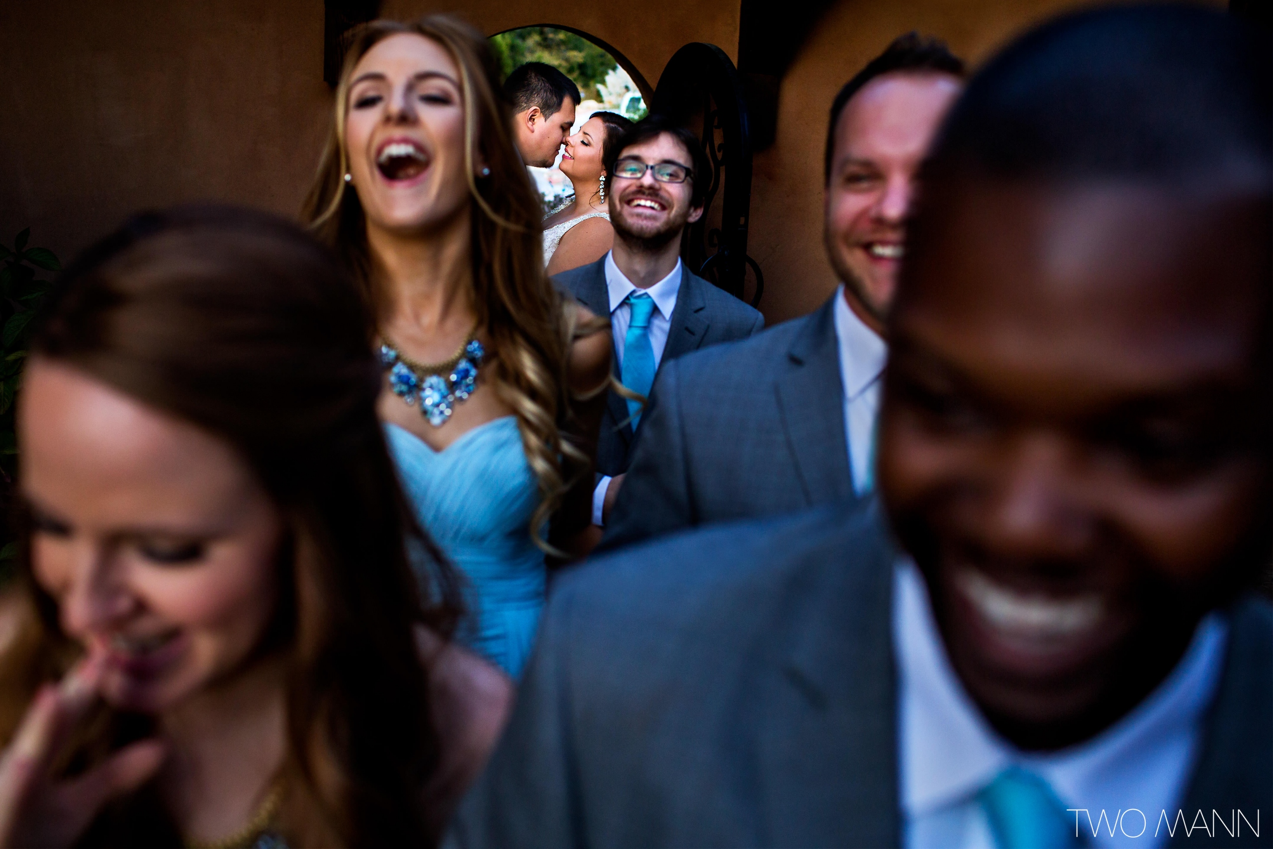 smiling faces of newlyweds and their friends