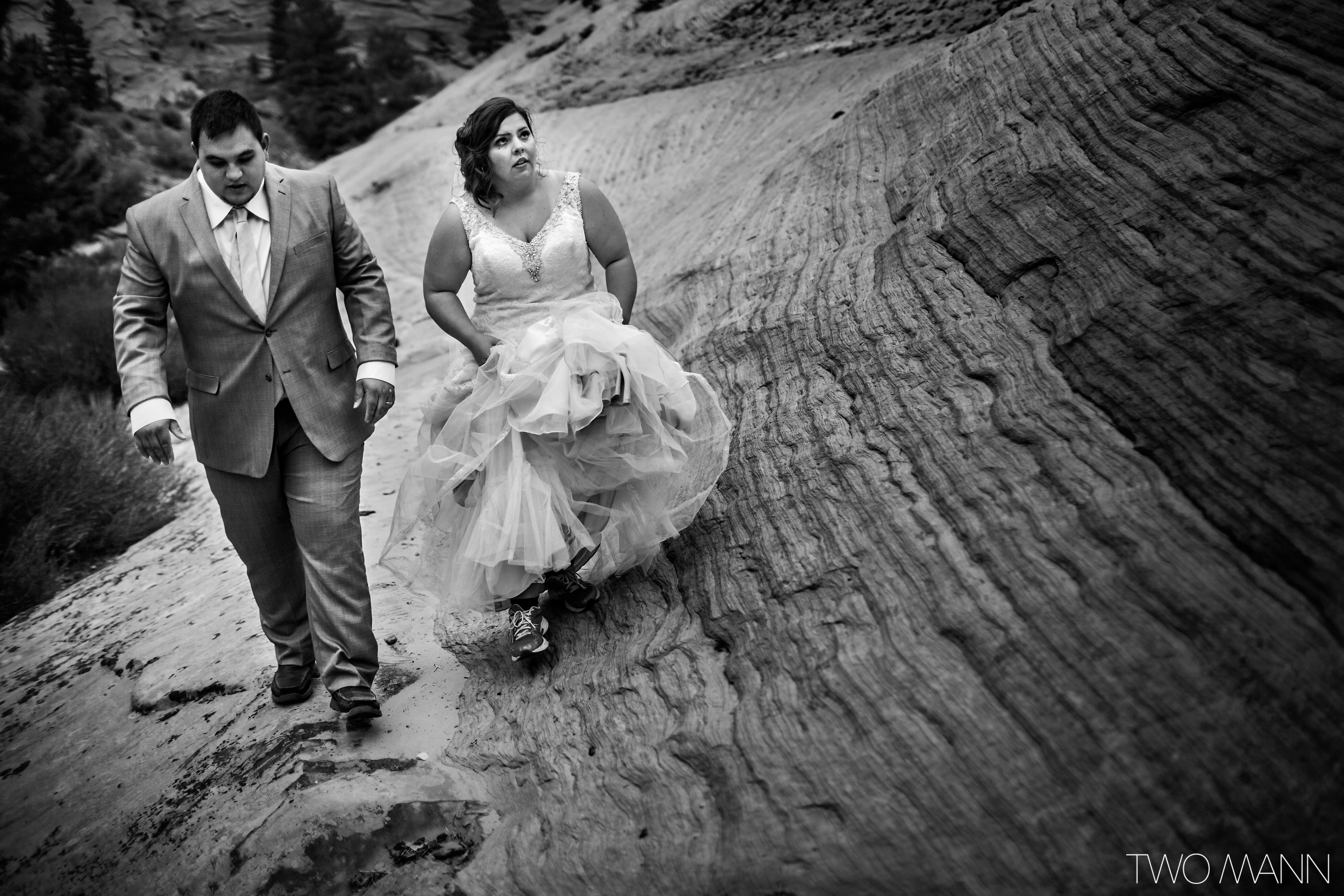 bride and groom take a stroll in Zion National park