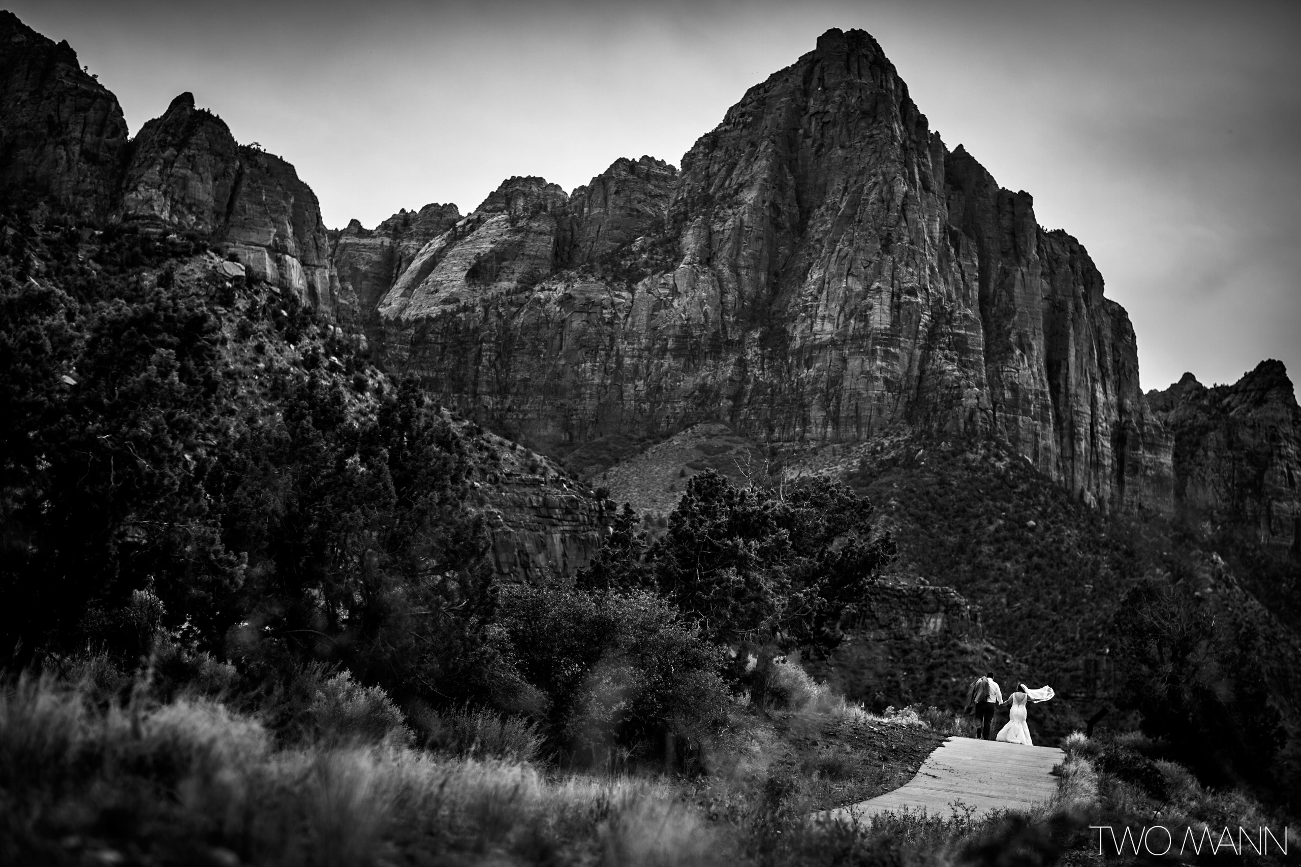 back view of newlywed walking on trails in Zion National Park