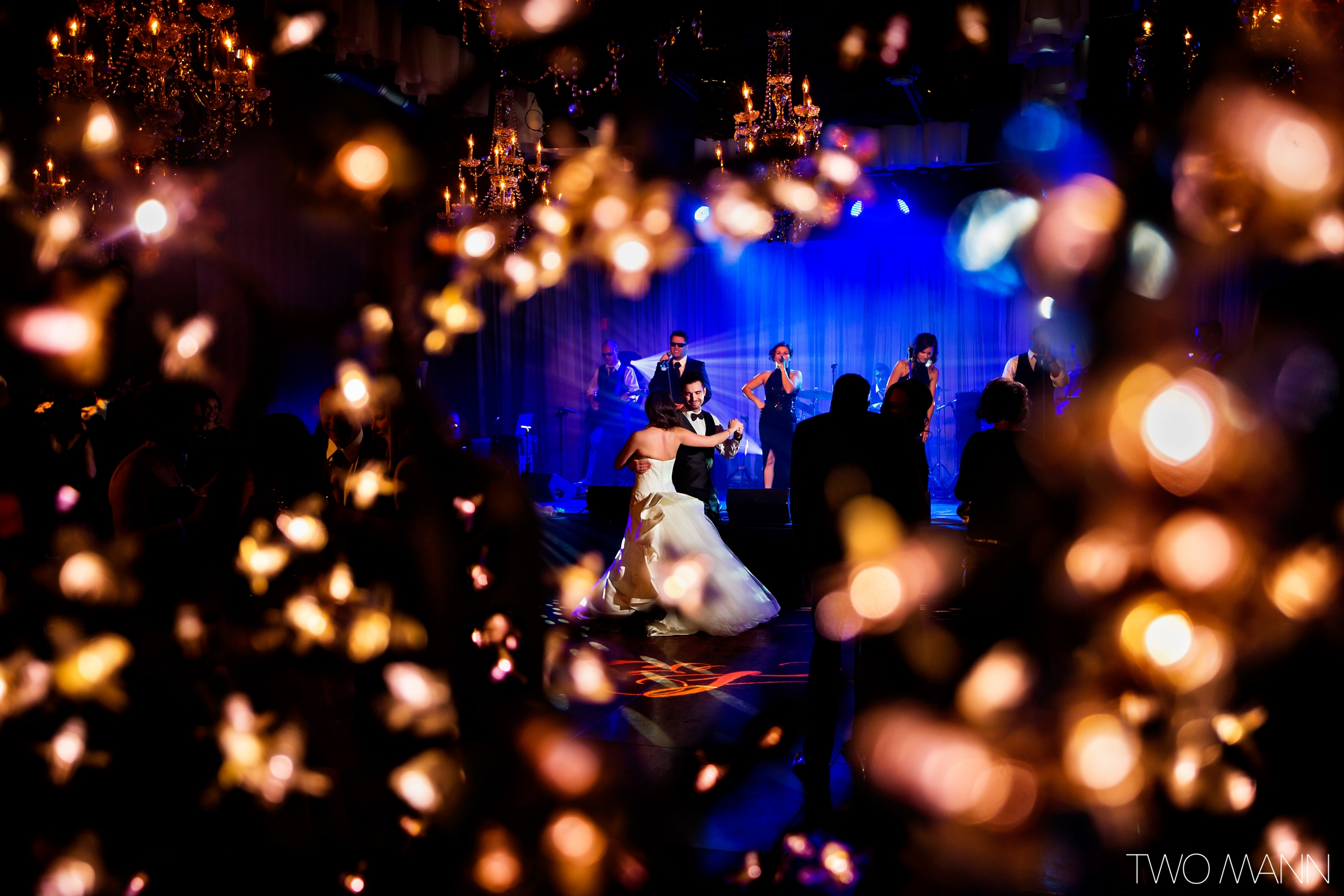 newlyweds' first dance in sparkle lights at the reception