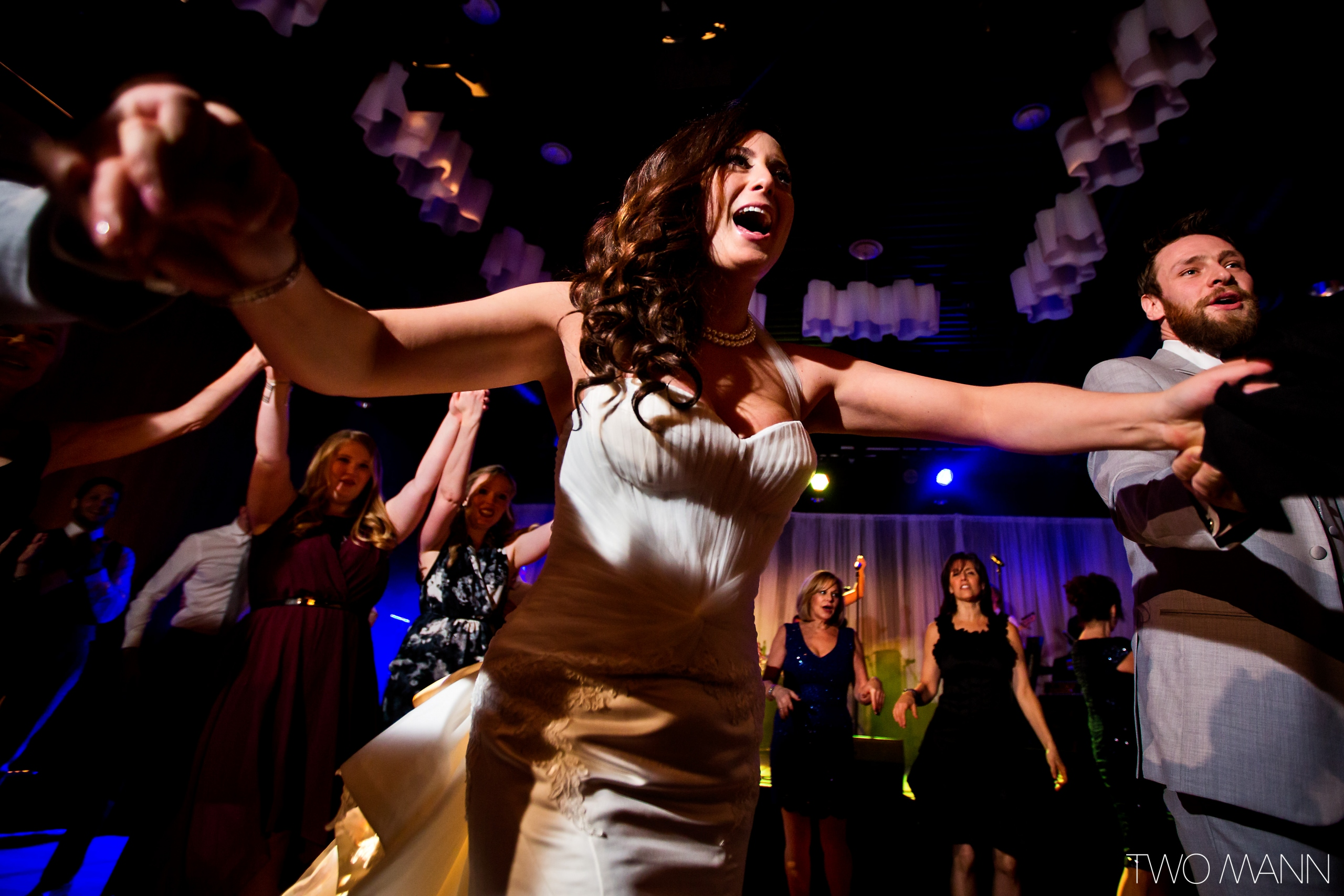 bride and guests dancing together