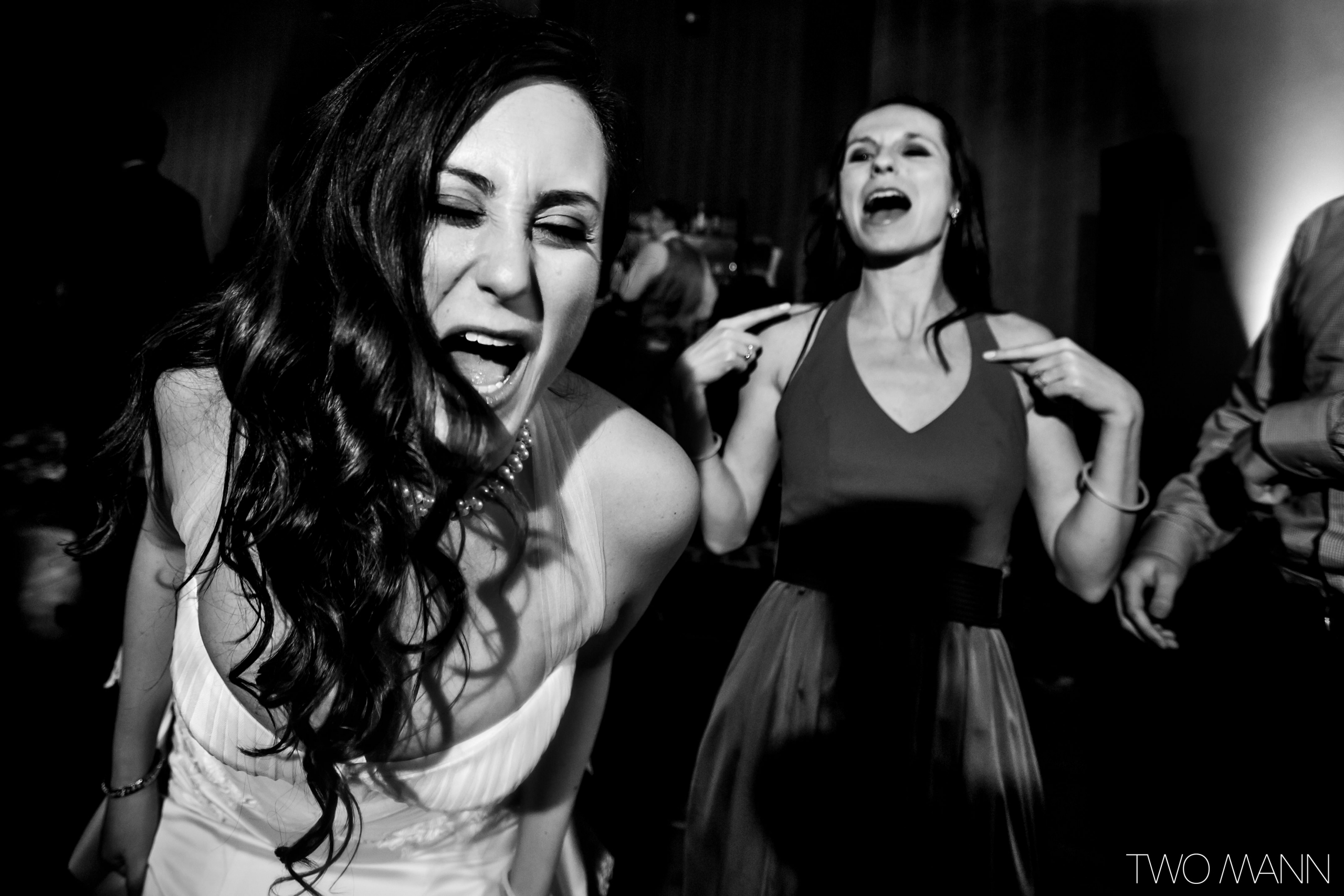 a bride and wedding guests hitting the dance floor