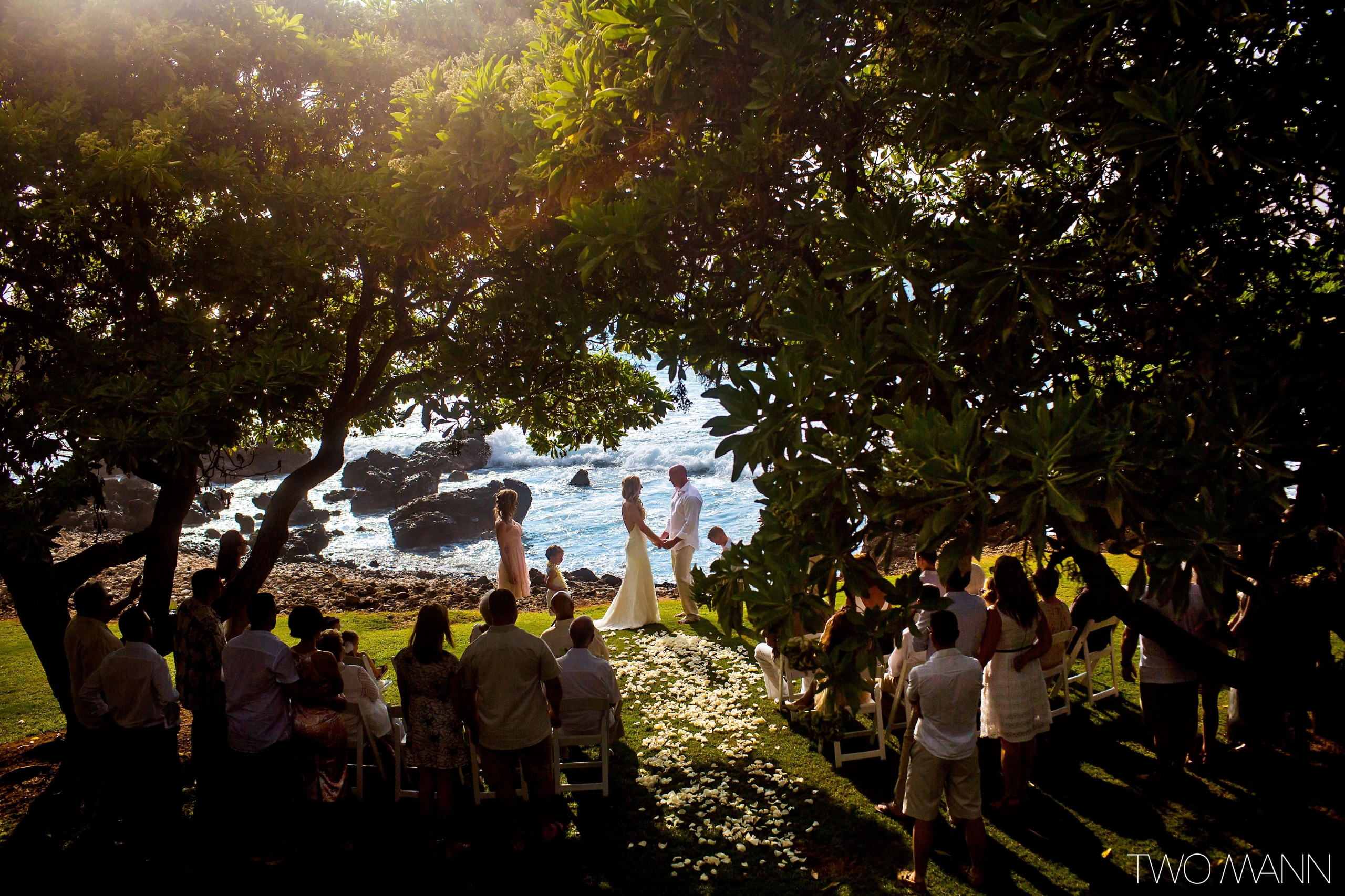 a quaint ocean-side wedding ceremony on a lava rock cove in Maui
