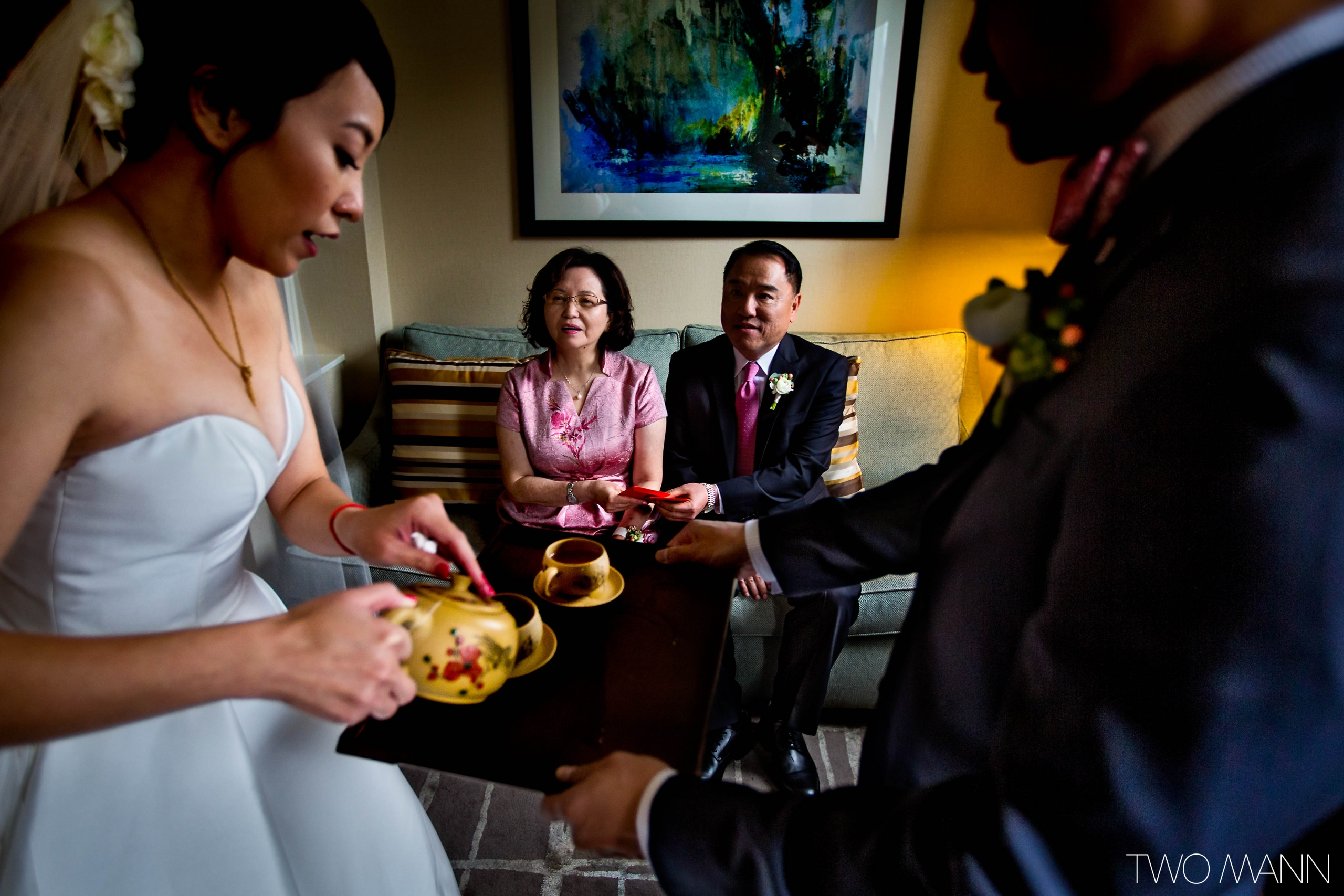 bride and groom serving tea to parents before wedding ceremony