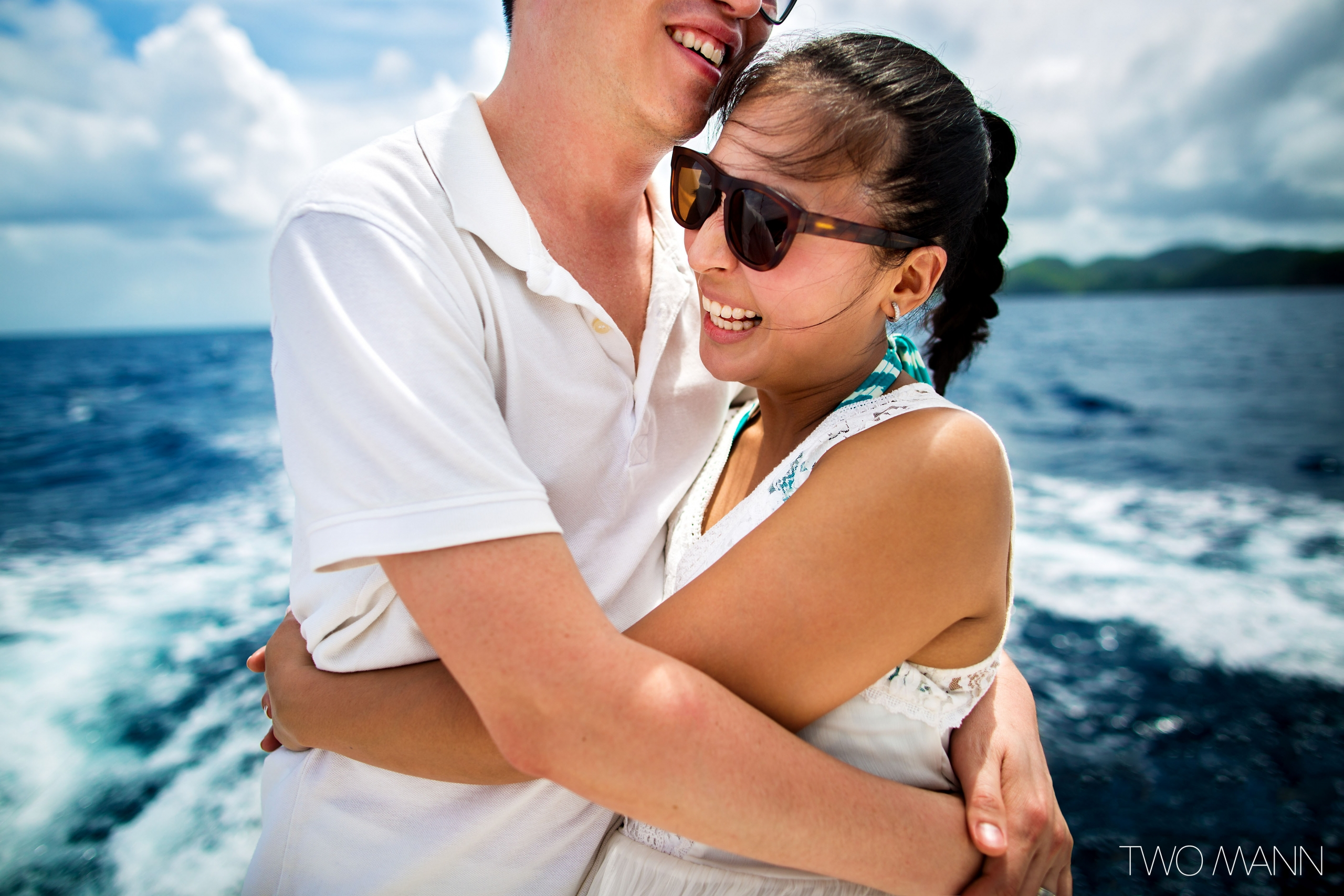 bride and groom hugging on sea background