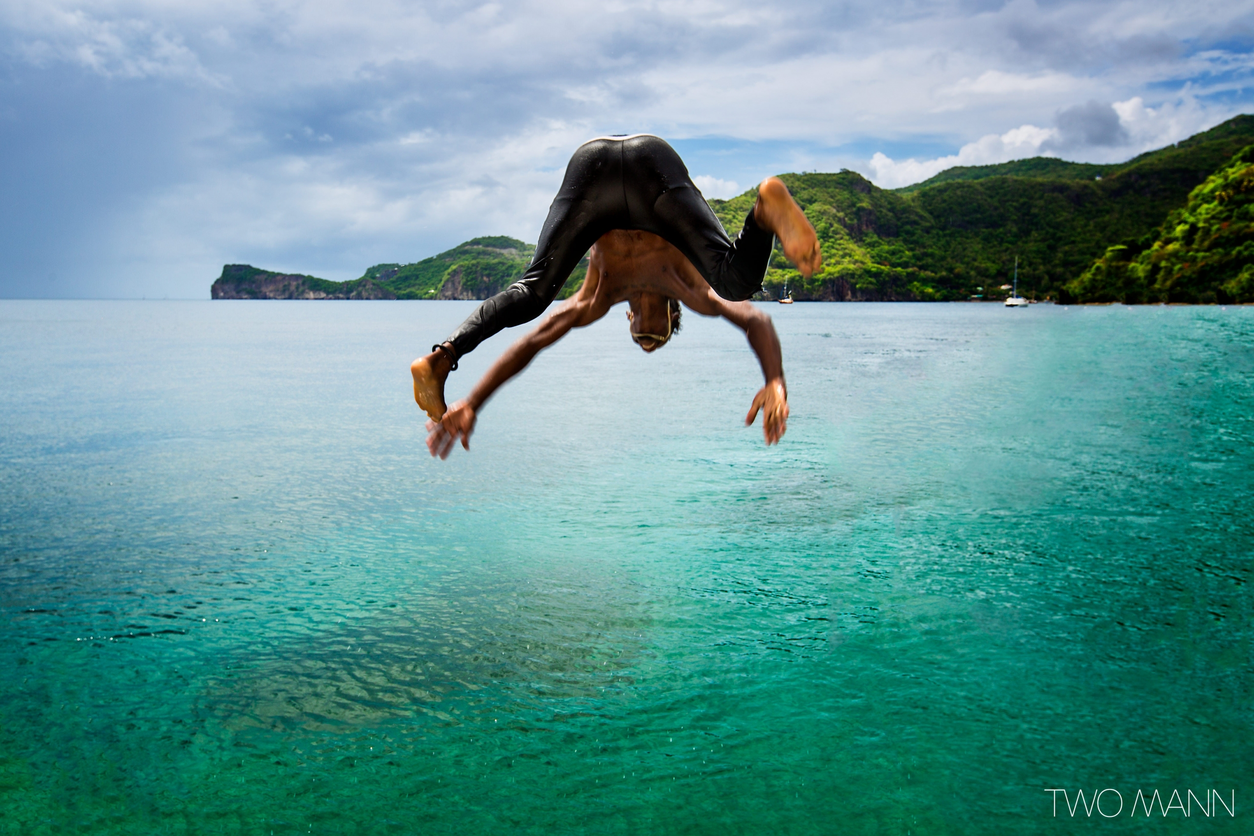 a wedding guest diving into the sea