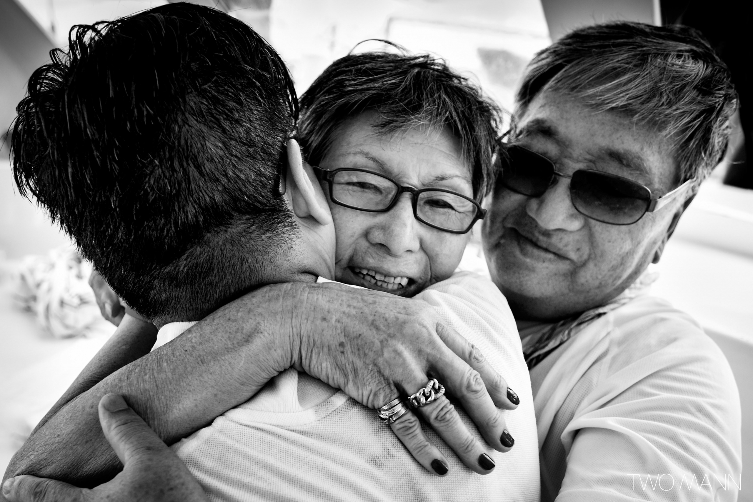 a groom hugging with his parents