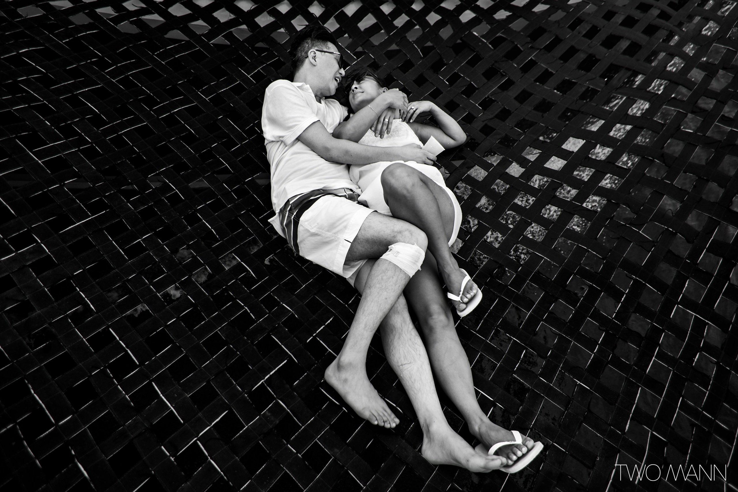young couple lying on hanging bed