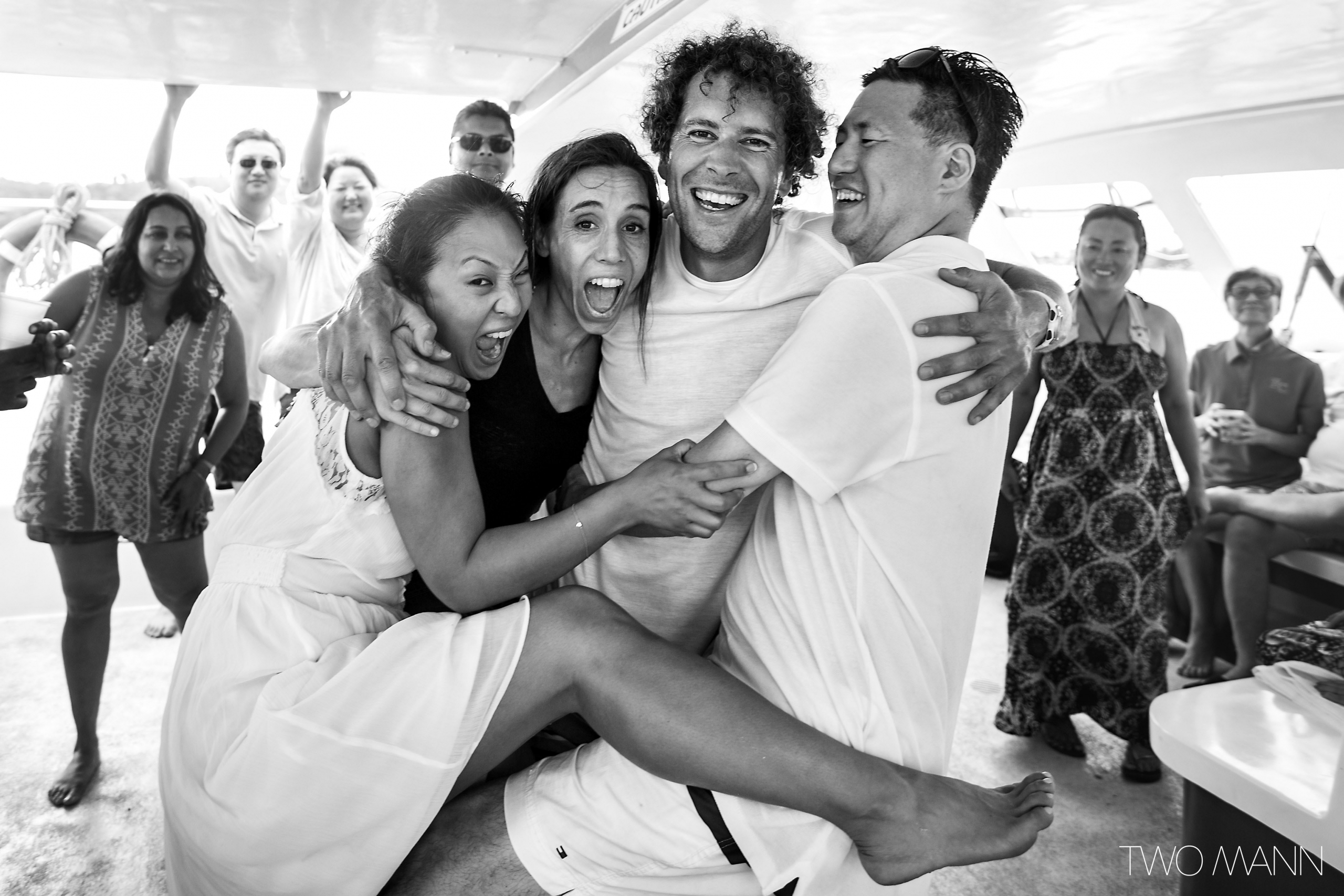 newlyweds hugging with twomann photographers in St. Lucia