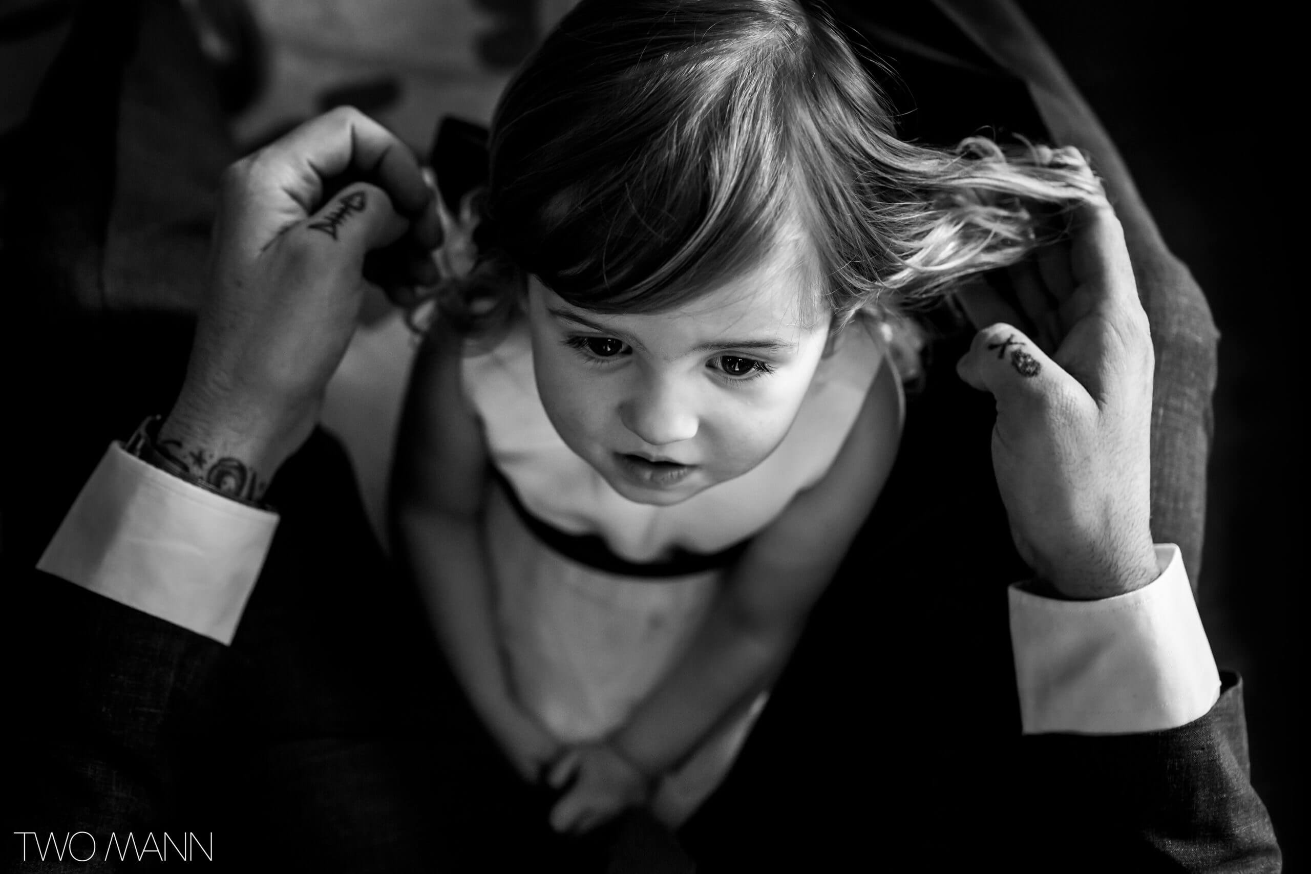 little girl getting ready for her parents' wedding ceremony