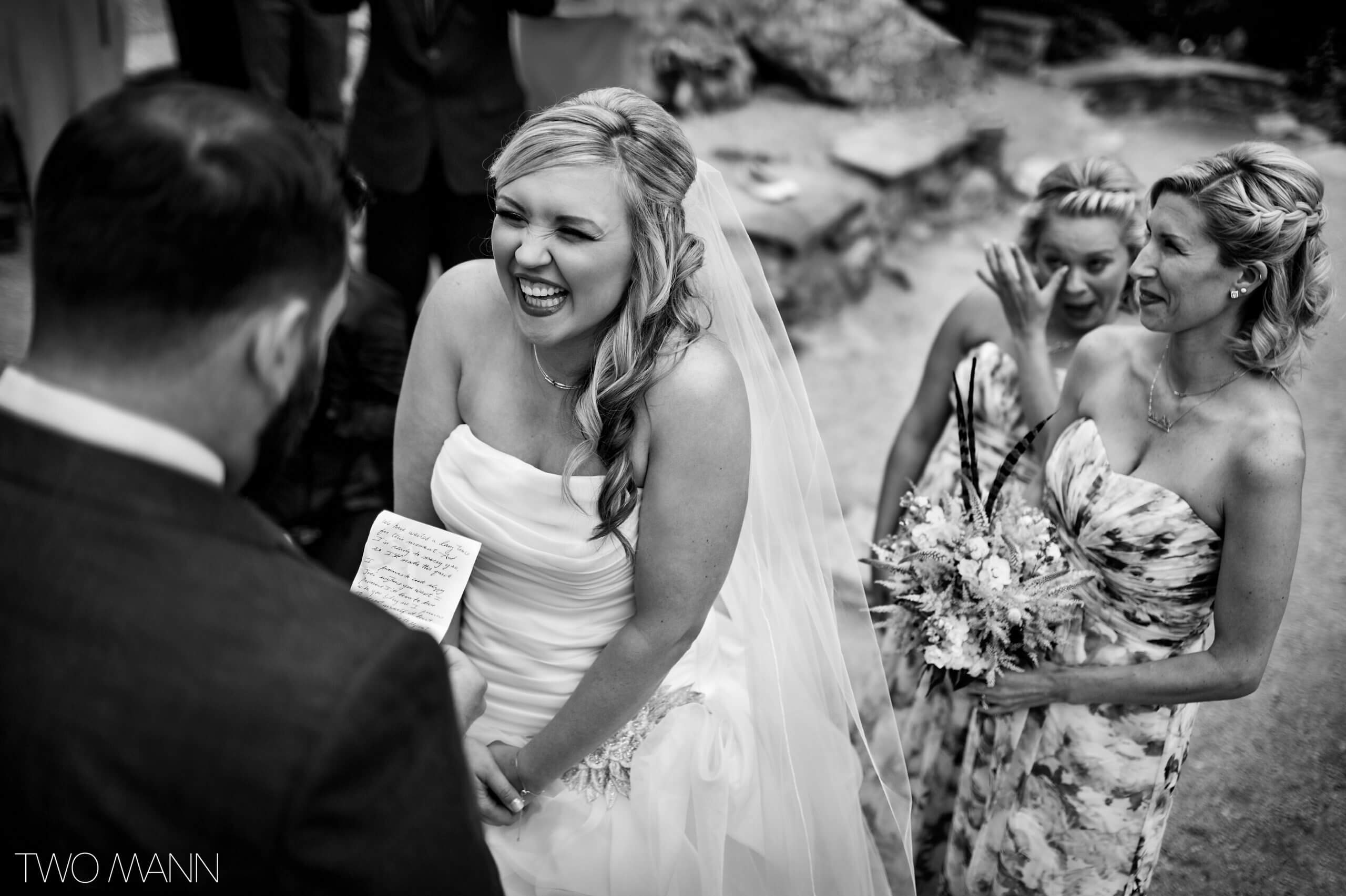 bride happily listening to Groom reading vows