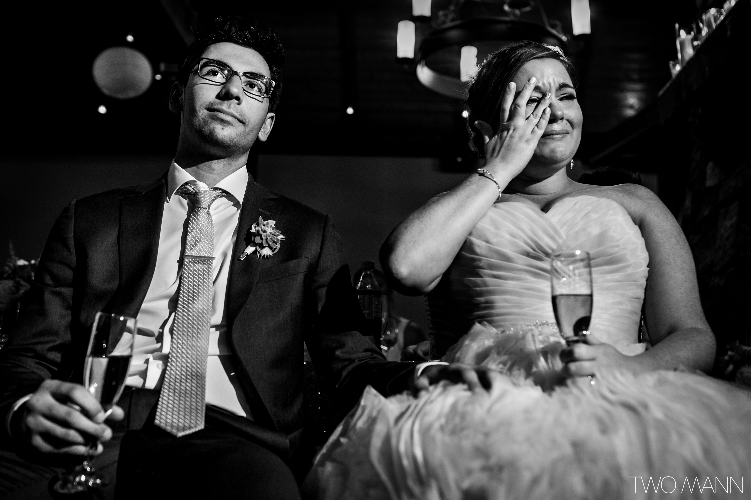 emotional bride and groom at the reception