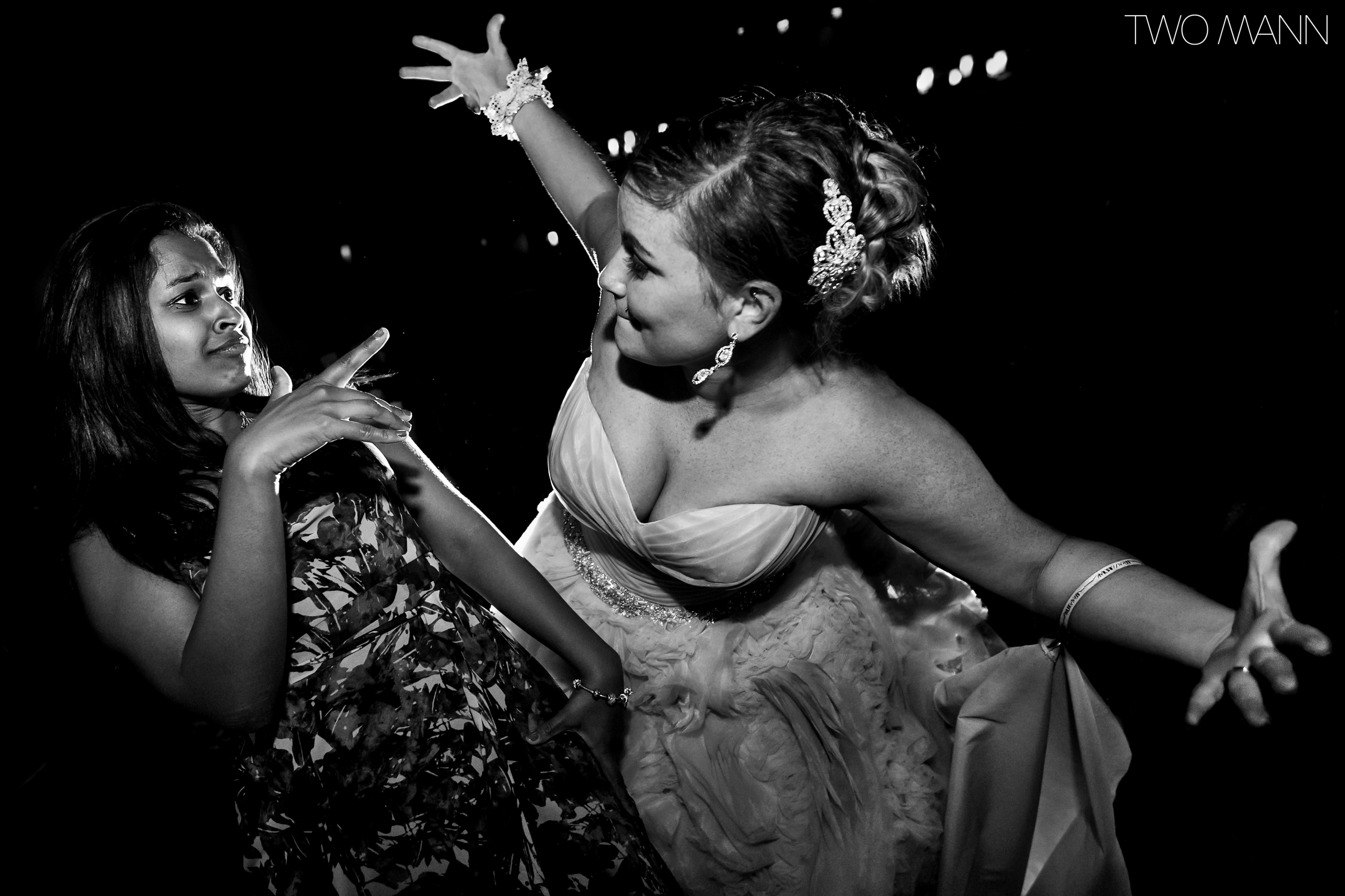 a bride dancing together with a lady at the reception