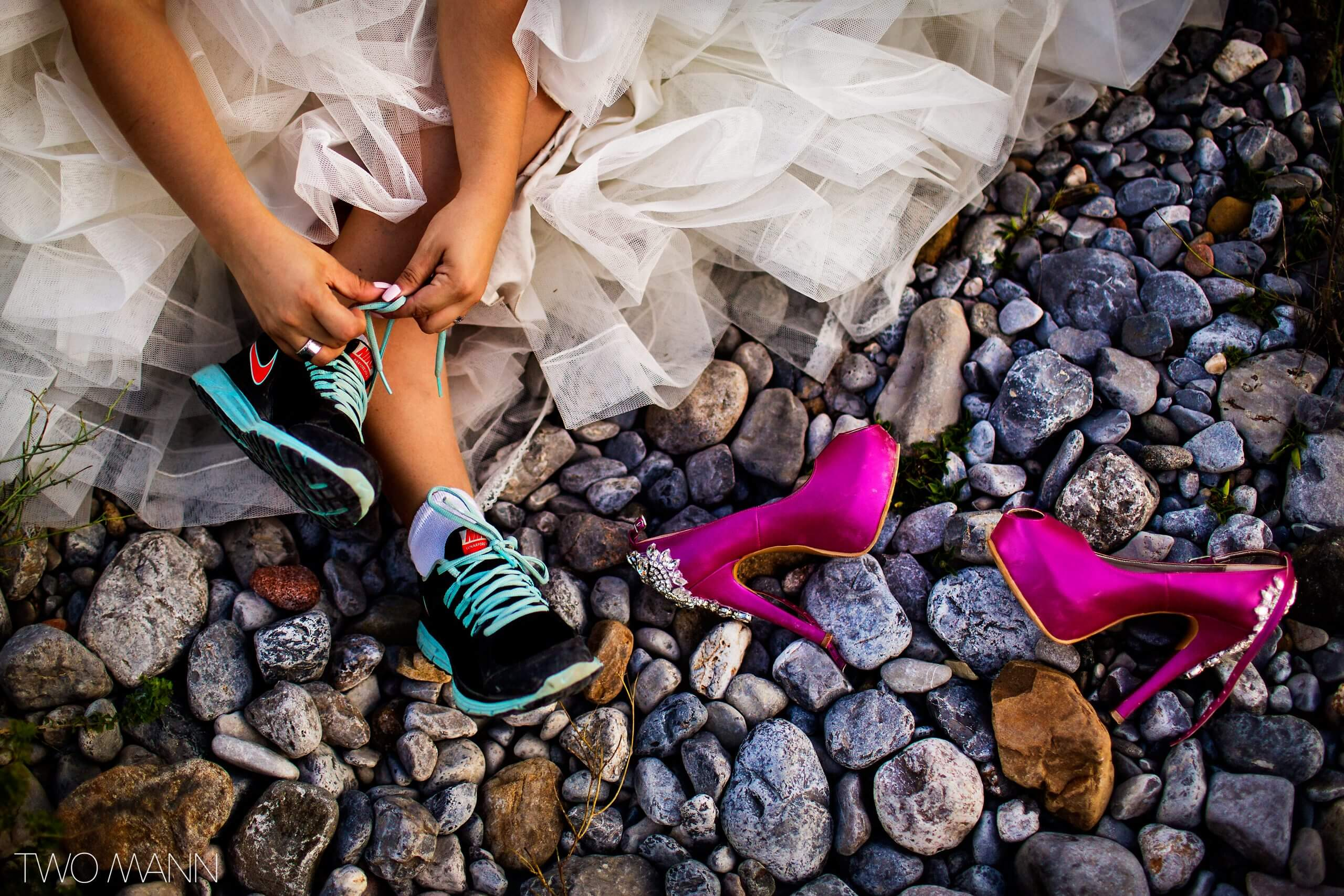 bride changing from heels to flats after wedding ceremony