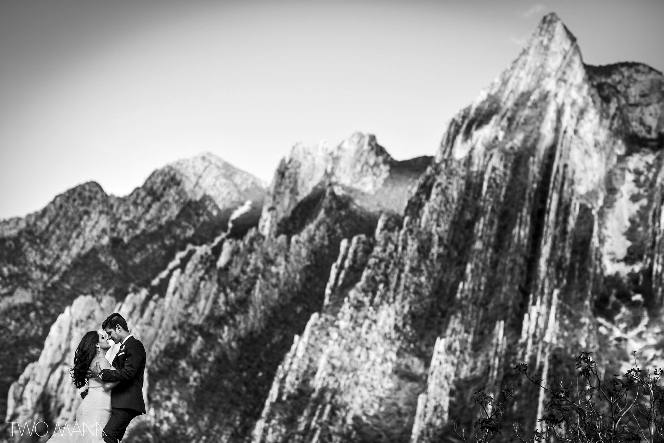 bride and groom looking in each other's eyes on a background of mountains