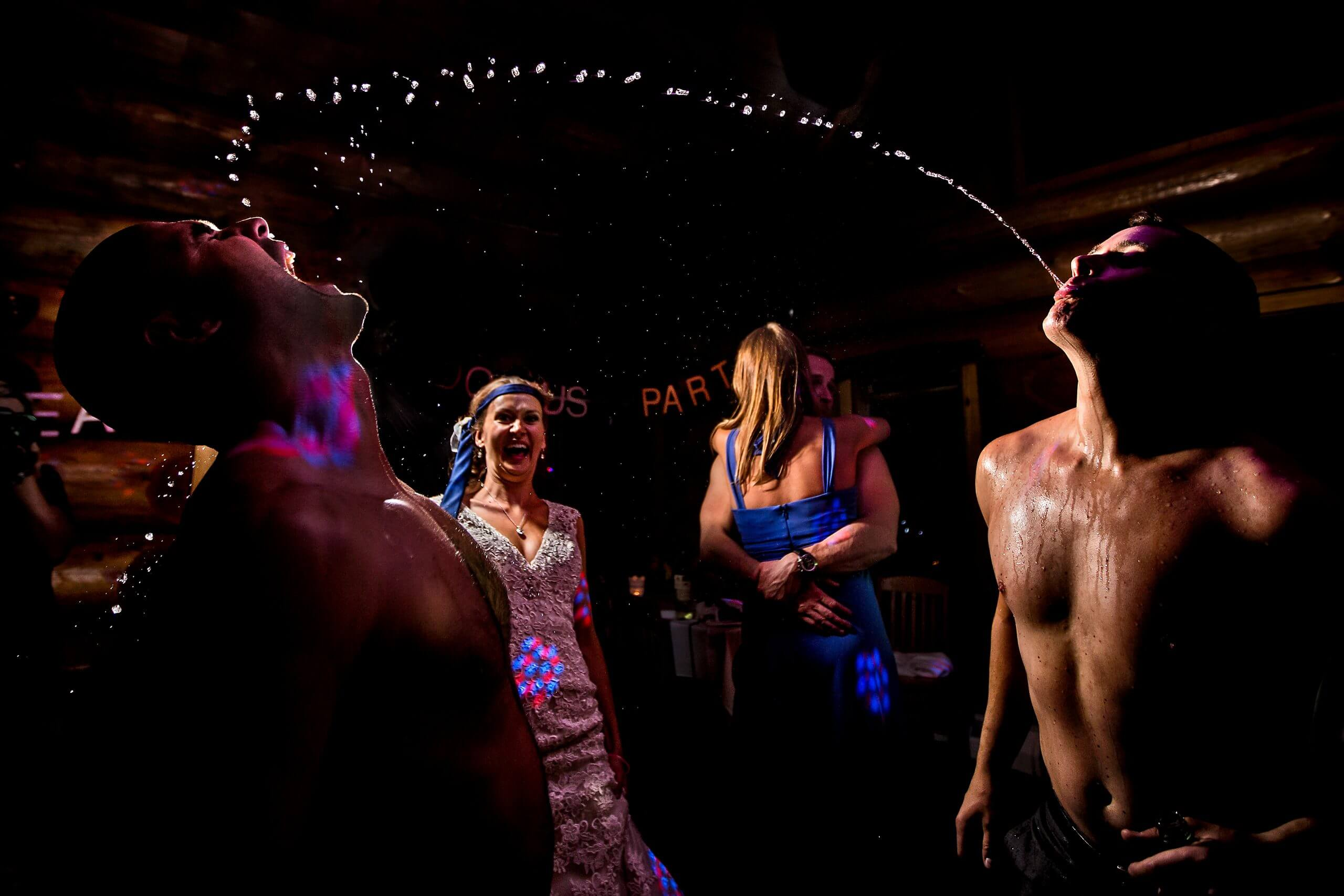 Two people playing the laughter game at two mann studio's wedding photography workshop