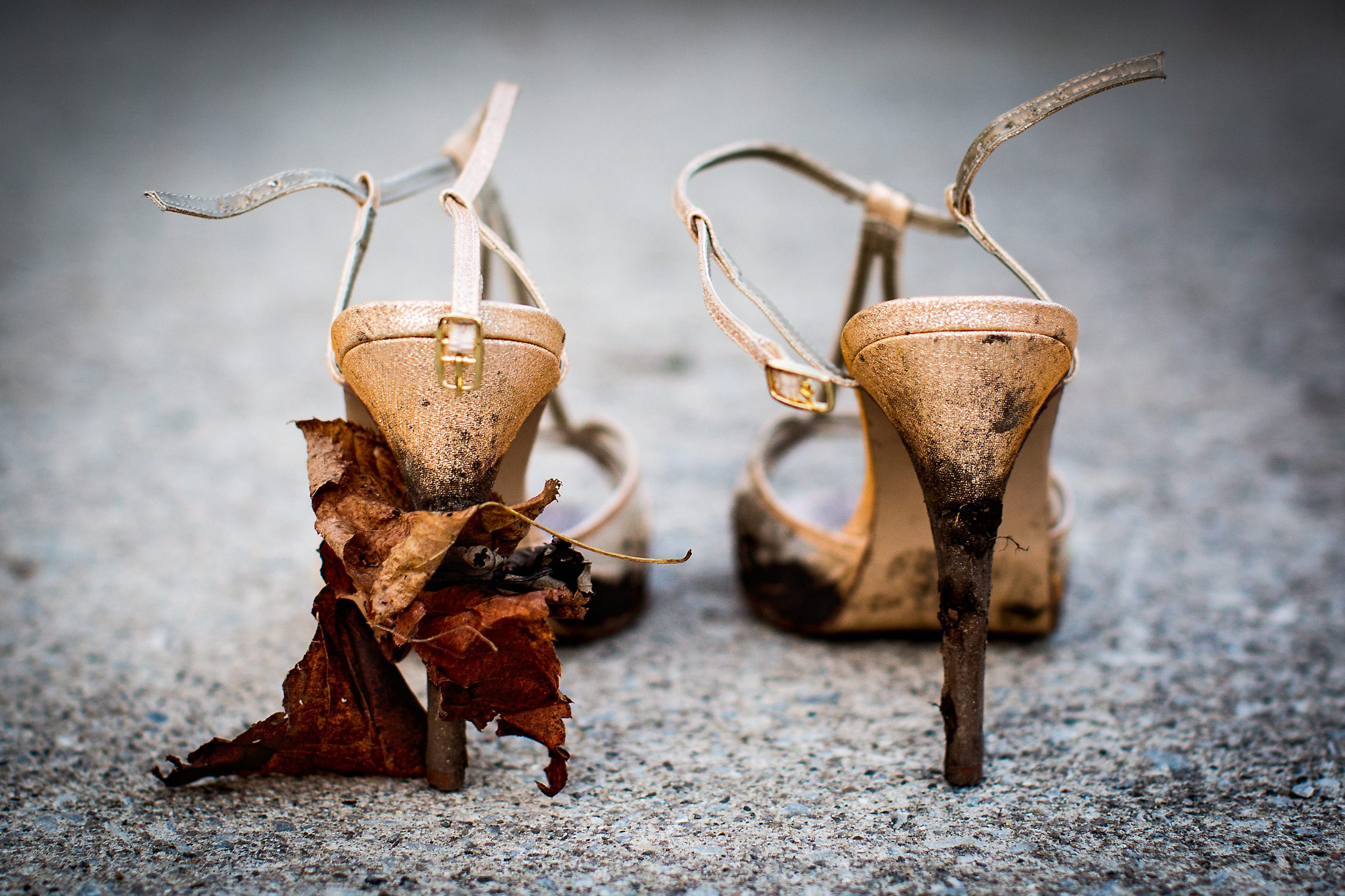 Muddy high heels with leaves stuck to heel