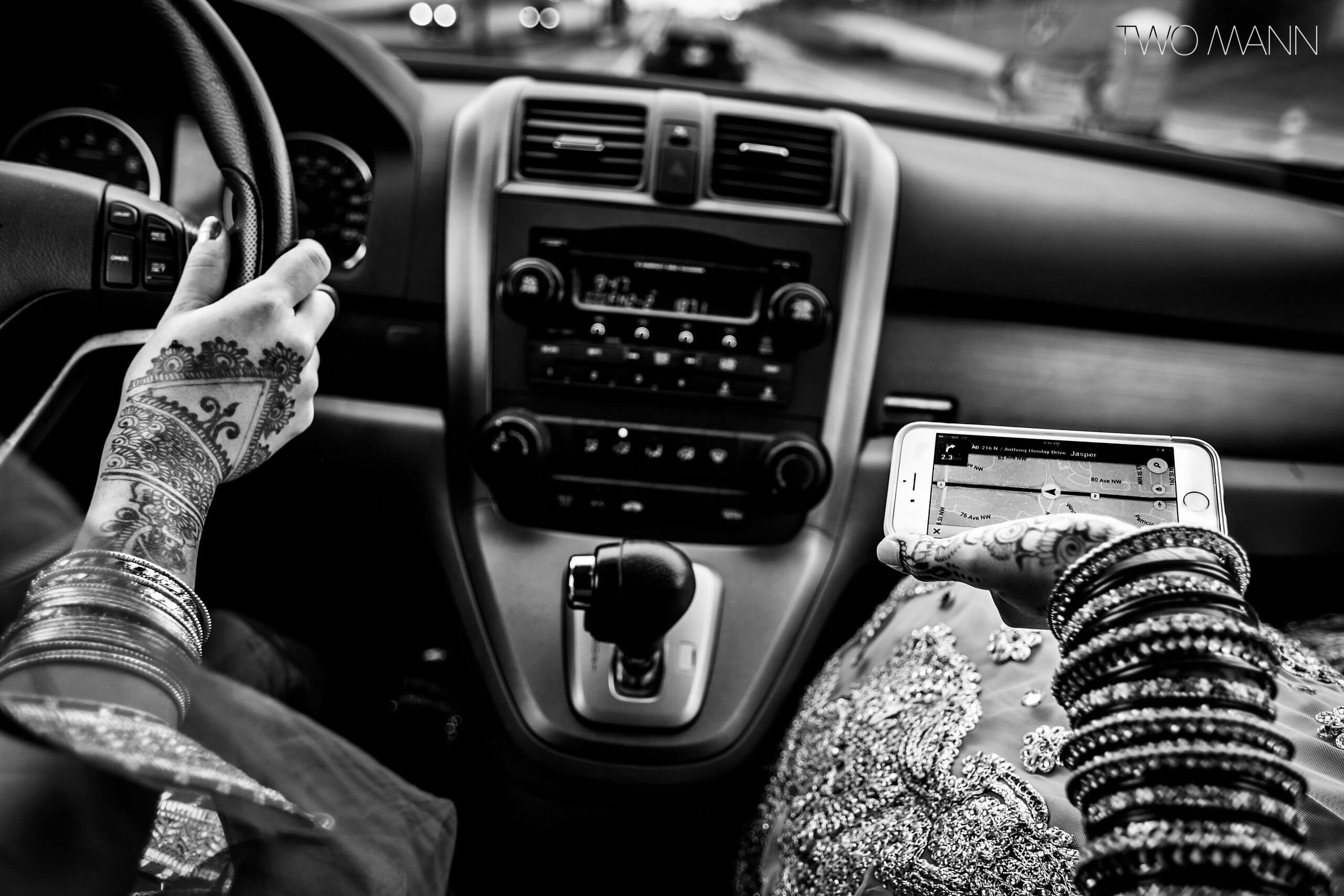 women with mehndi driving to an indian wedding ceremony