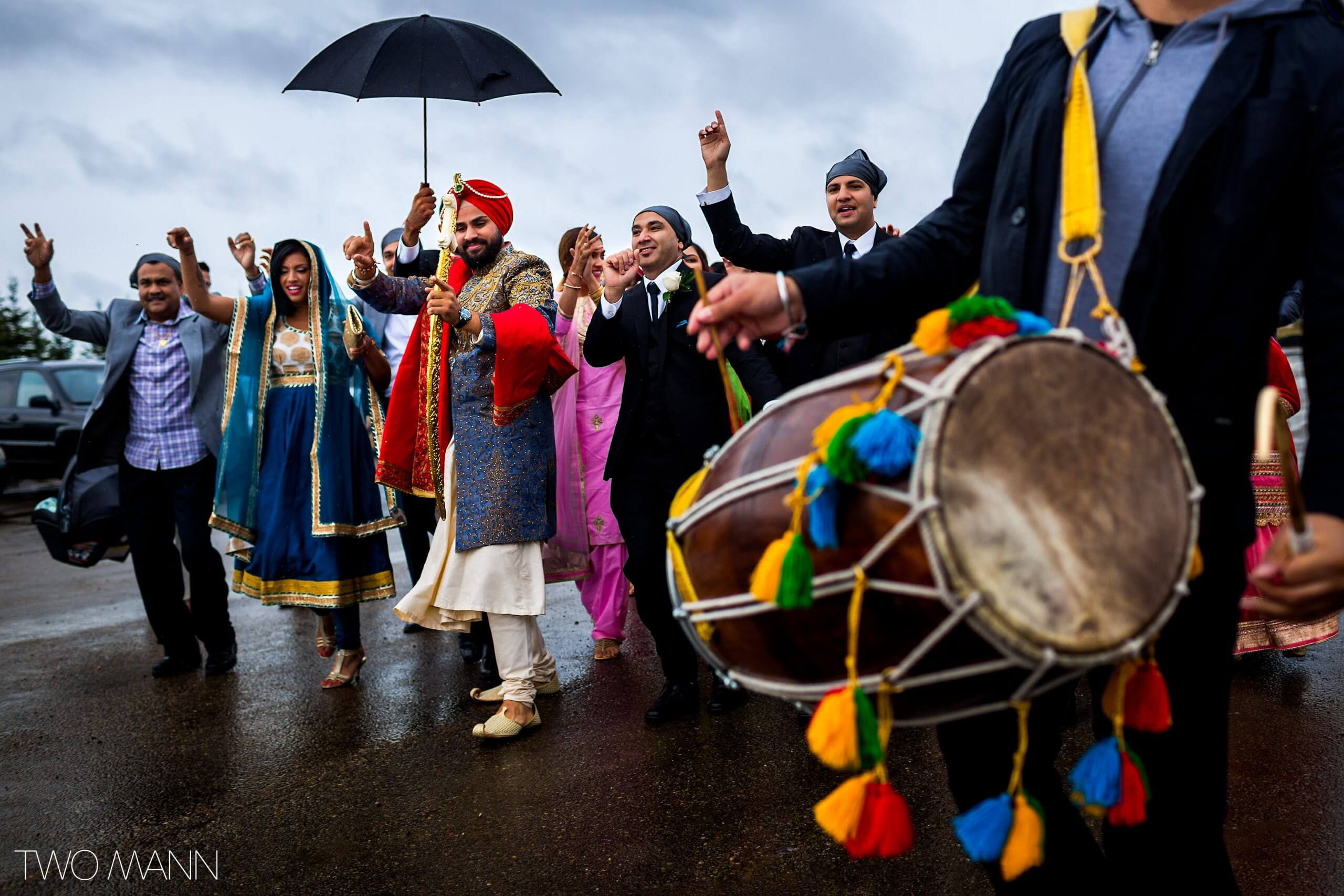dance with the beat of drum at an Indian wedding ceremony